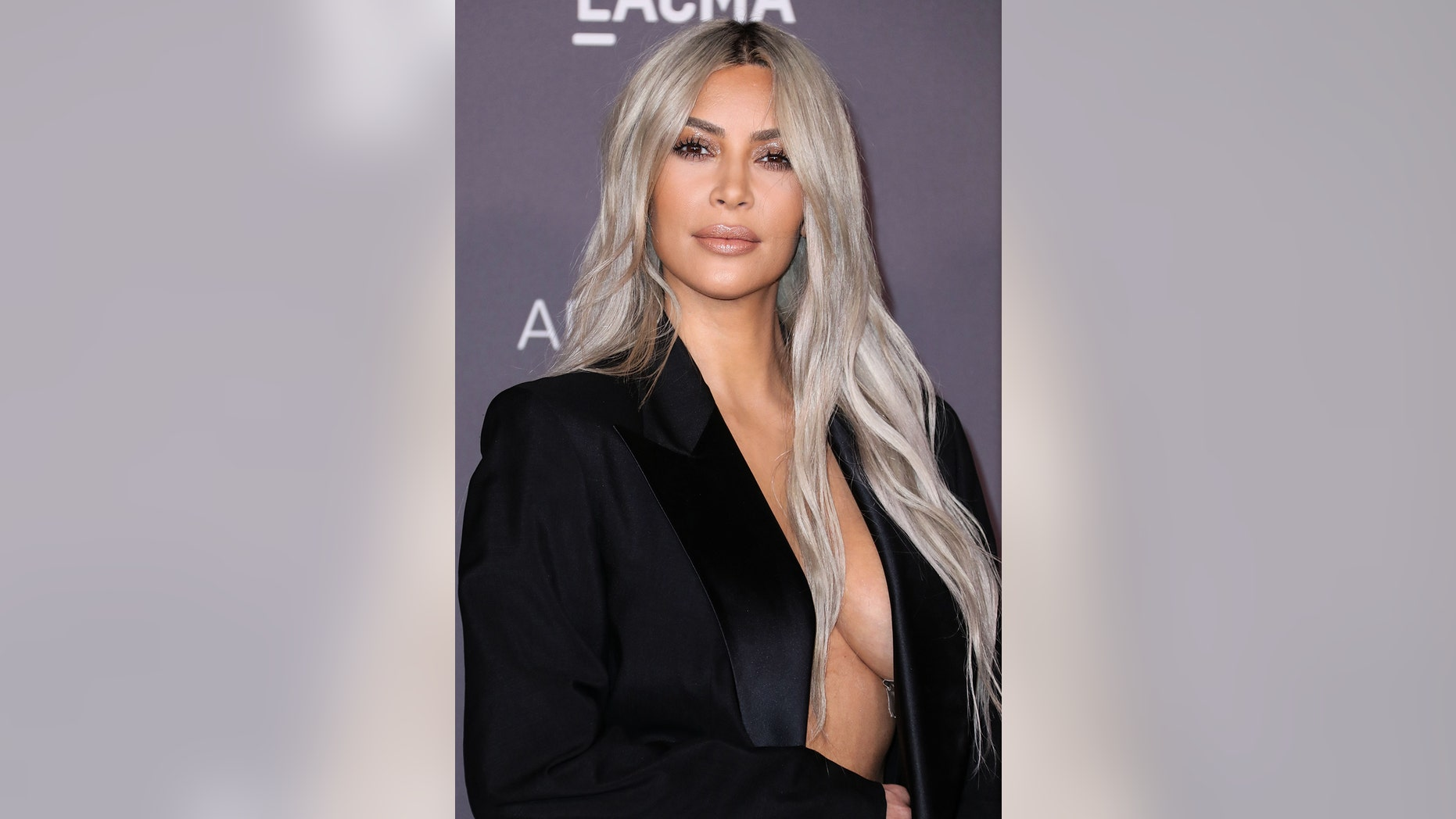 Kim Kardashian sparked outrage online by posting a topless photo taken by her four-year-old daughter.