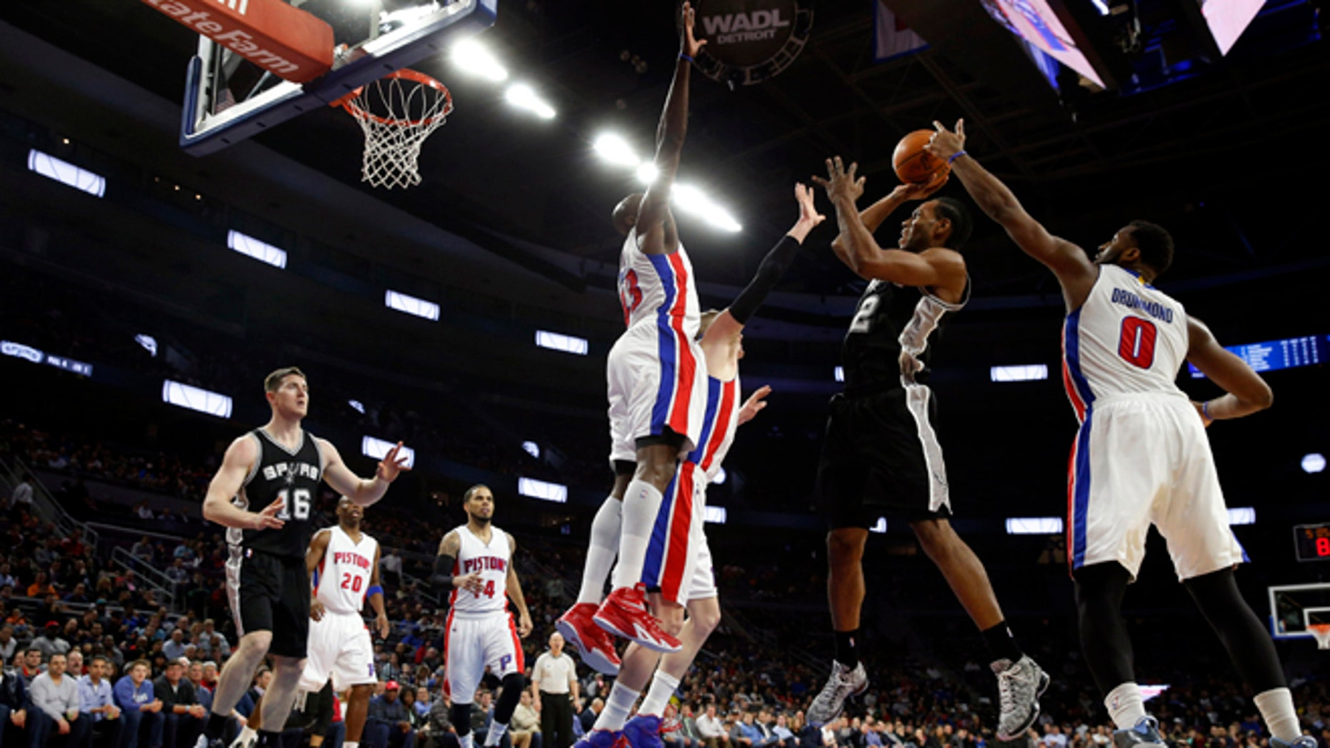 San Antonio Spurs forward Kawhi Leonard (2) shoots against the Detroit Pistons in the first half of an NBA basketball game in Auburn Hills, Mich., Wednesday, Feb. 11, 2015. (AP Photo/Paul Sancya)