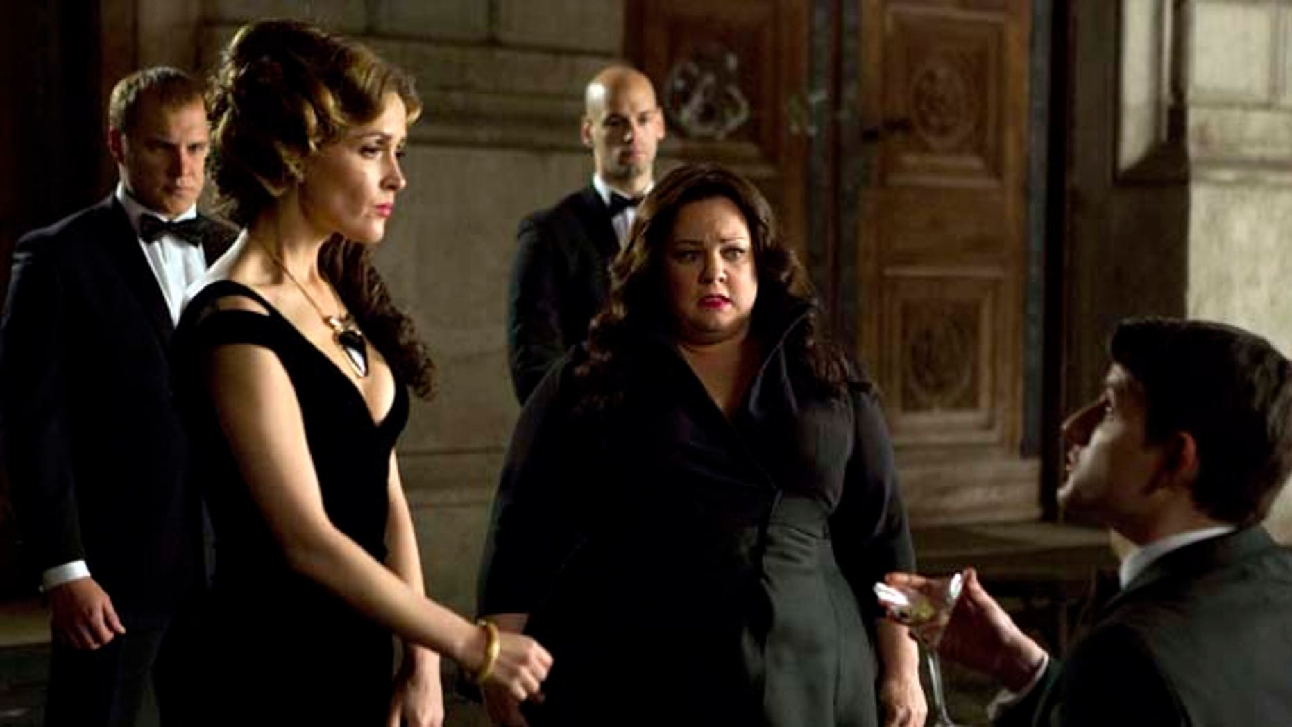 """This photo provided by Twentieth Century Fox shows, Melissa McCarthy, second right, infiltrating an arms dealing ring led by Rose Byrne, left, in a scene from the film, """"Spy."""""""