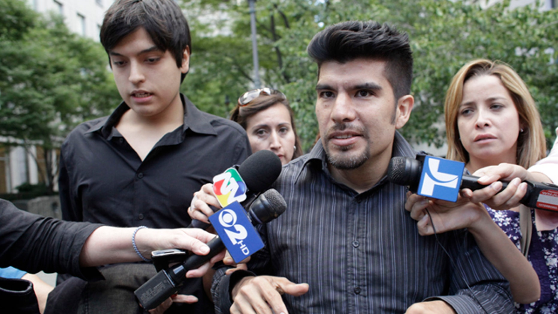 Juan Jose Lazaro, left, and Waldo Mariscal, have been left in the lurch after their mother, Vicky Pelaez, was deported to Russia. (AP)