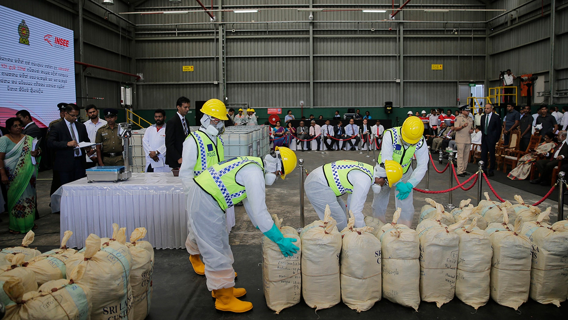 Sri Lankan police officers in protective outfits prepare to destroy a haul of seized cocaine during a ceremony at an industrial facility in Katunayaka, outskirts of Colombo, Sri Lanka in January.