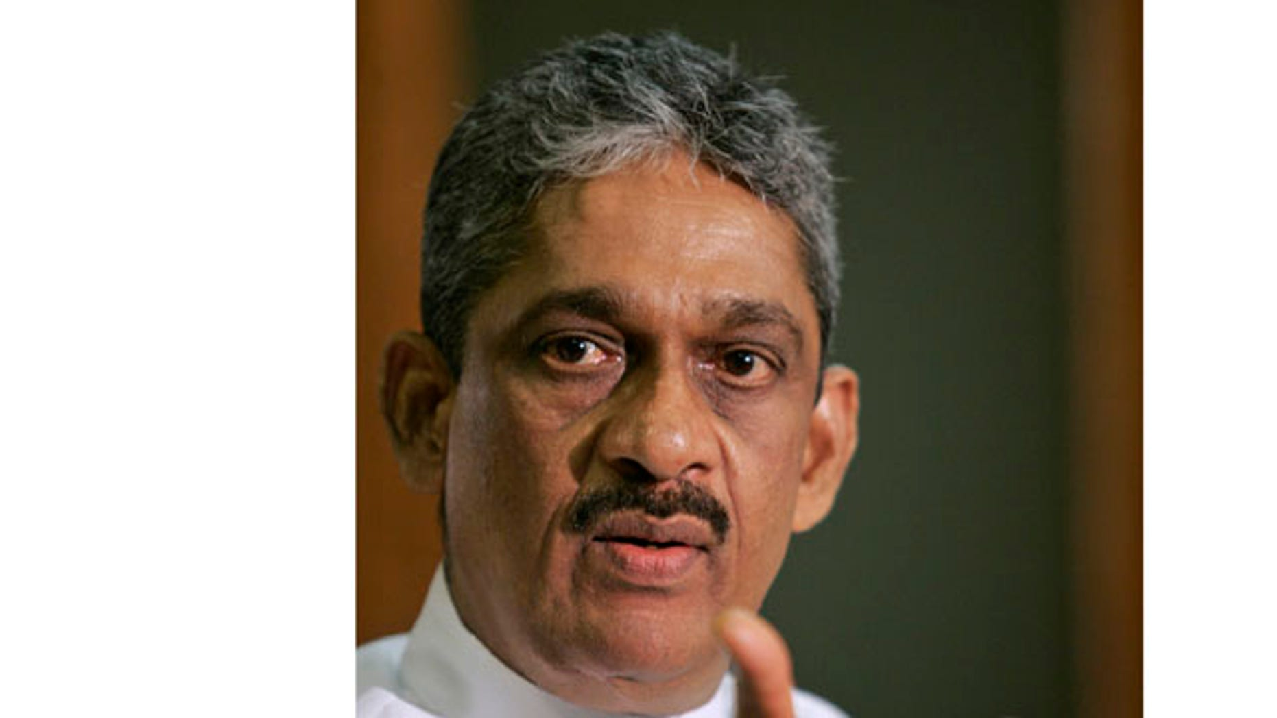 In this Sept. 8, 2010 file photo, Sri Lankan lawmaker and former military chief Sarath Fonseka addresses the media in Colombo, Sri Lanka.