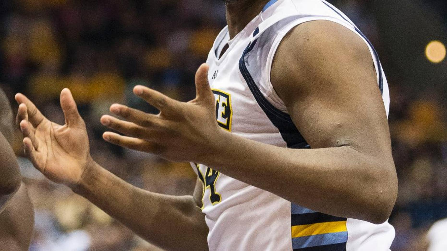 Marquette's Davante Gardner looks for a foul call on the St. John's defense during the first half of an NCAA college basketball game Saturday, March 8, 2014, in Milwaukee. (AP Photo/Tom Lynn)