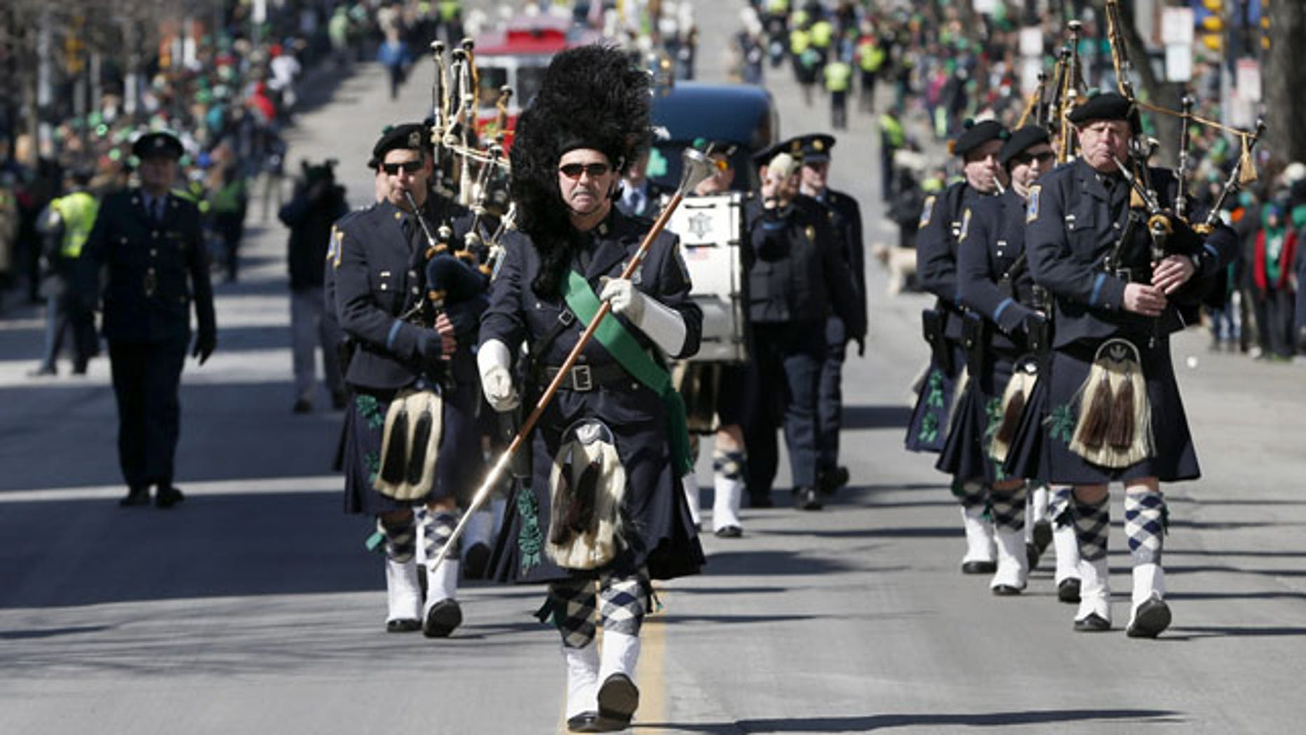 March 16, 2014: The Boston Police Gaelic Column marches in the annual St. Patrick's Day parade in the South Boston neighborhood of Boston. (AP Photo/Michael Dwyer)