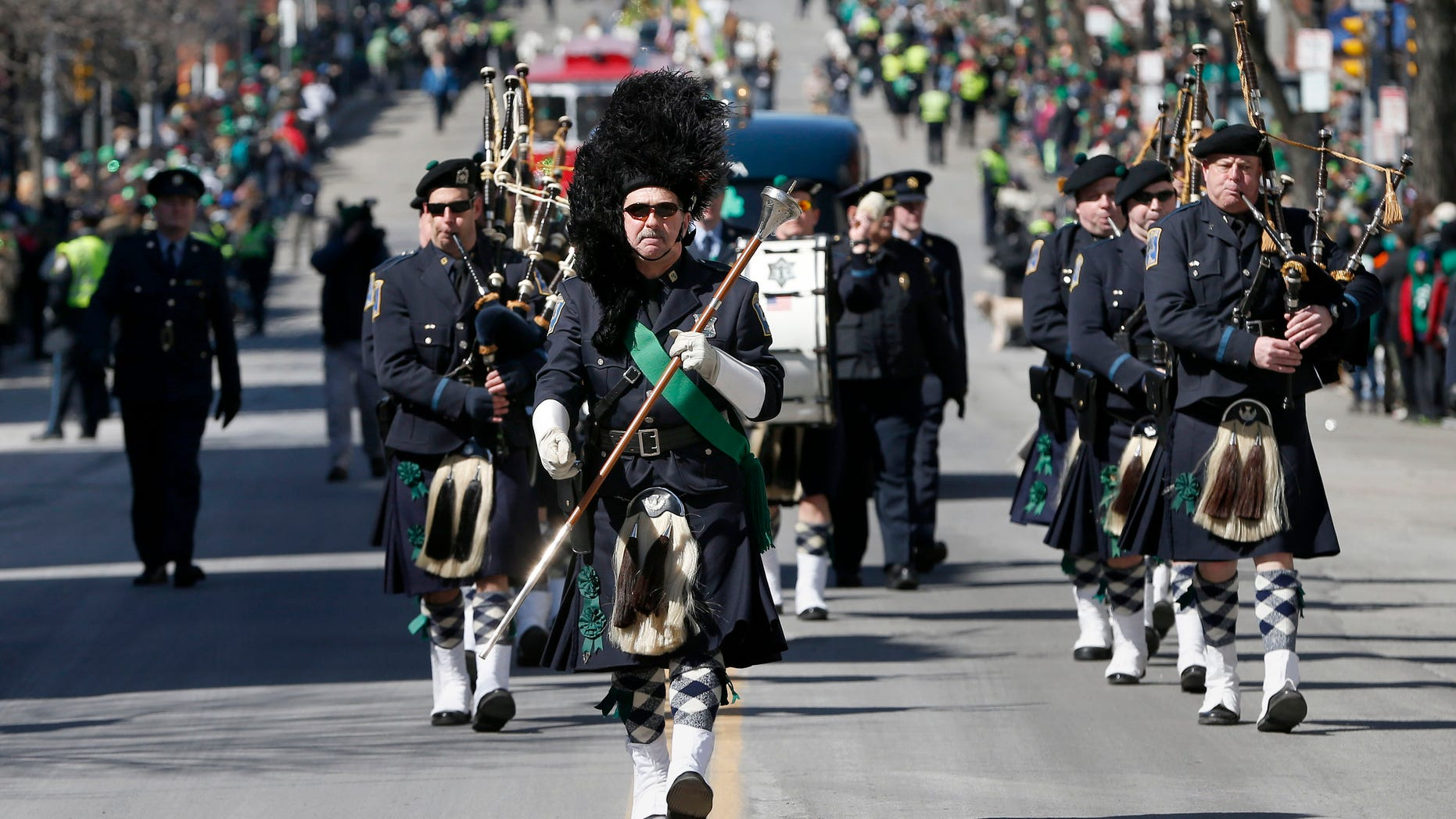 The Boston Police Gaelic Column marches in the annual St. Patrick's Day parade in the South Boston neighborhood of Boston, Sunday, March 16, 2014.