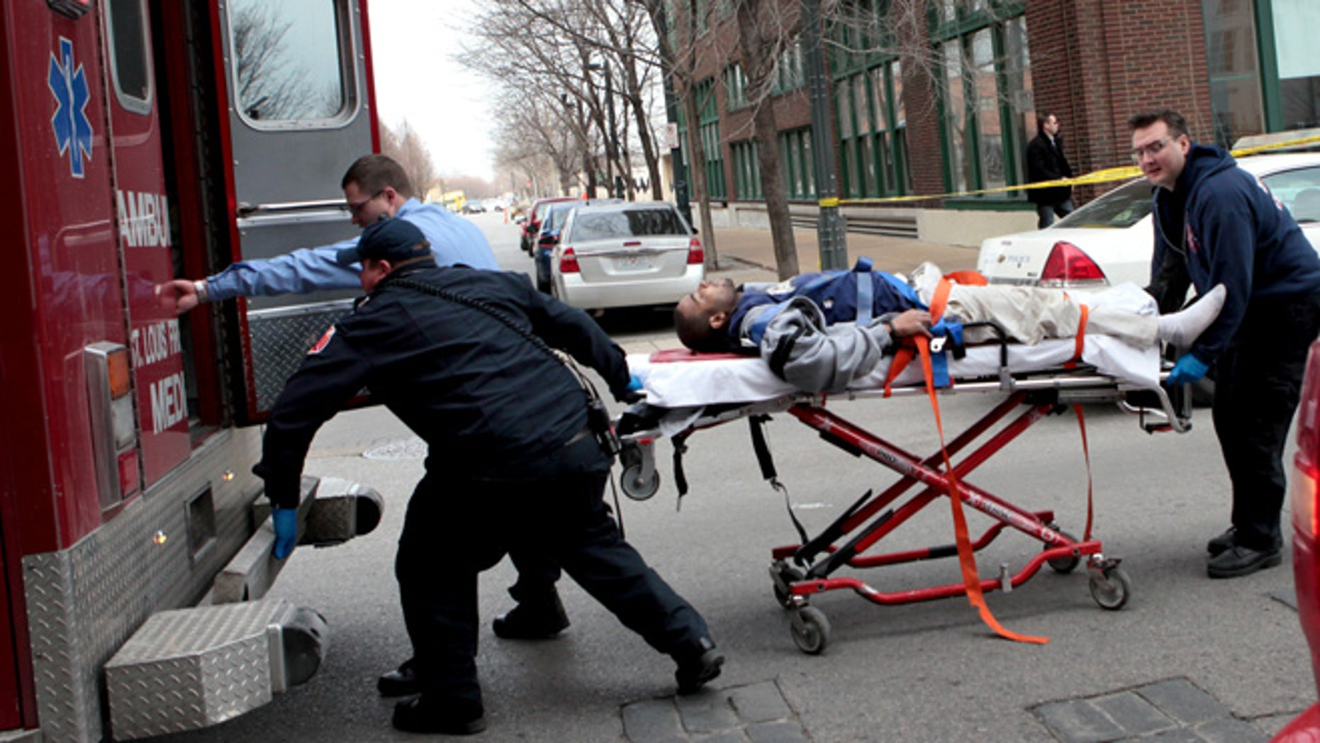 Jan. 15, 2013: Police and emergency personnel transport a man to an ambulance after a shooting at Stephens Institute of Business and Arts on Washington Avenue in St. Louis.