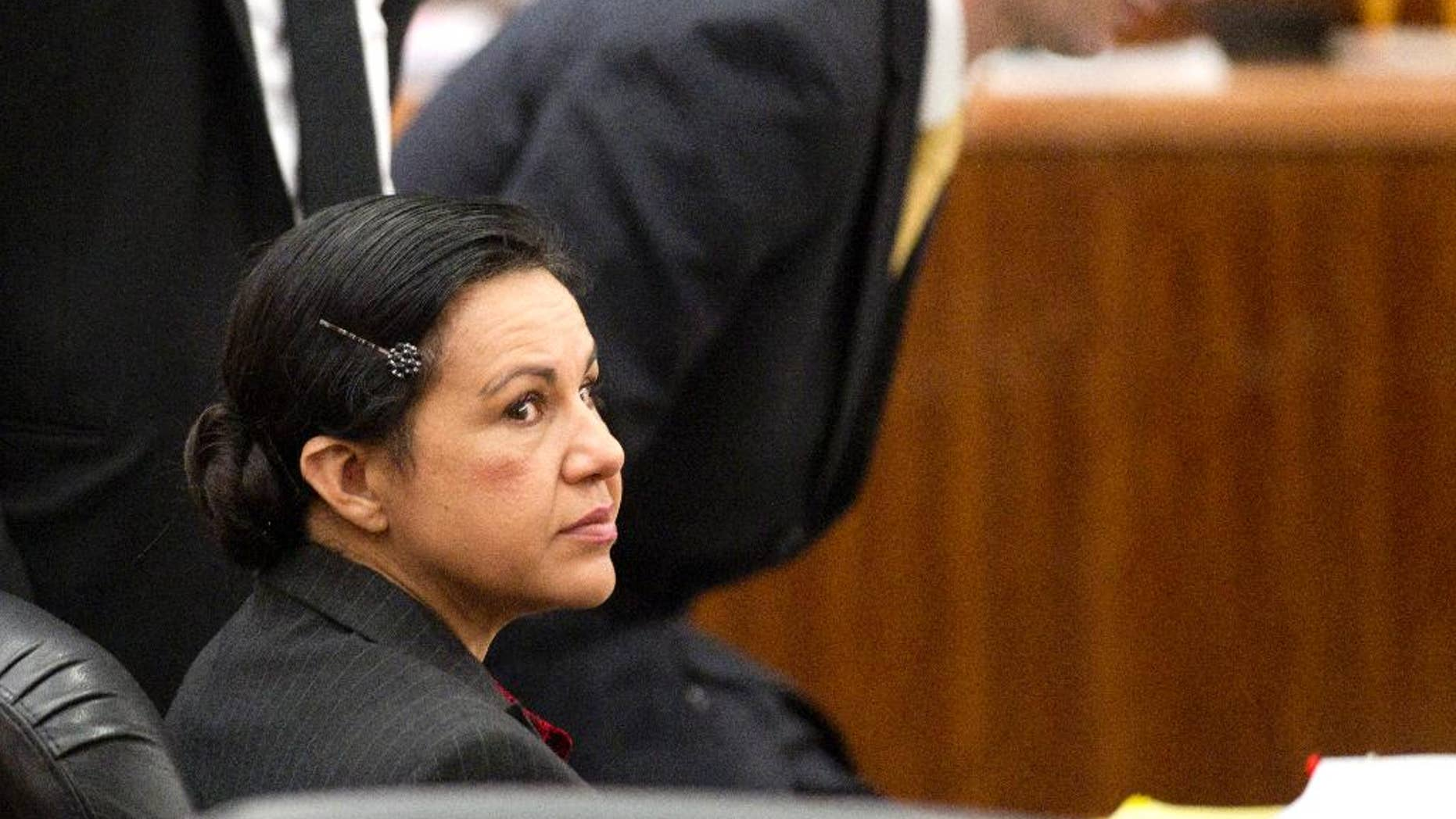 Ana Lilia Trujillo, left, sits in the courtroom before opening arguments in her trial, Monday, March 31, 2014, in Houston. Trujillo, 45, is charged with murder, accused of killing her 59-year-old boyfriend, Alf Stefan Andersson, at his Museum District high-rise condominium in June 2013. (AP Photo/Houston Chronicle, Brett Coomer)