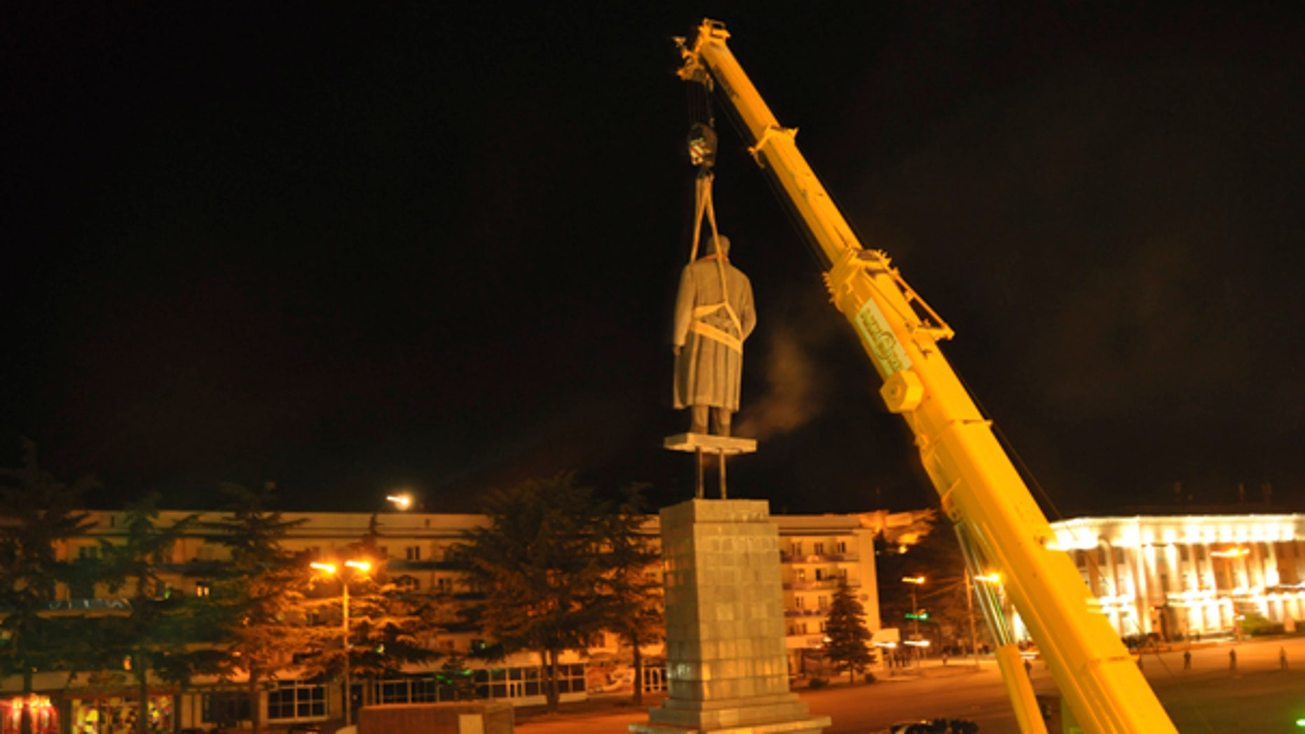 June 25: In this photo released by Gori region administration a statue of Soviet dictator Josef Stalin is dismantled at his home town of Gori, 80 kms (50 miles) west of the Georgian capital Tbilisi.  Authorities in Georgia have torn down a monument to Soviet dictator Josef Stalin in his birthplace of Gori to make way for a memorial to the fallen in the Russian-Georgian war of 2008. (AP)