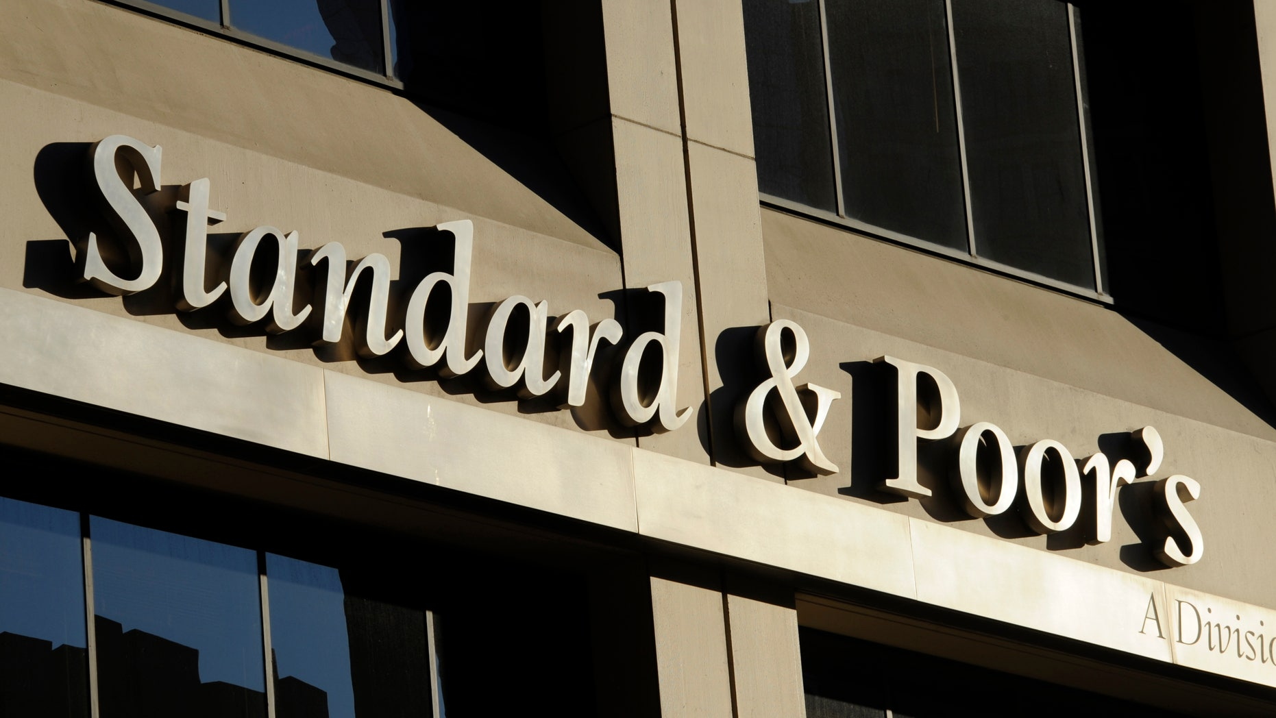 Oct. 9, 2011: File photo shows 55 Water Street, home of Standard & Poor's, in New York. S&P said Monday, Feb. 4, 2013, the U.S. government is expected to file civil charges against Standard & Poor's Ratings Services, alleging that it improperly gave high ratings to mortgage debt that later plunged in value and helped fuel the 2008 financial crisis.