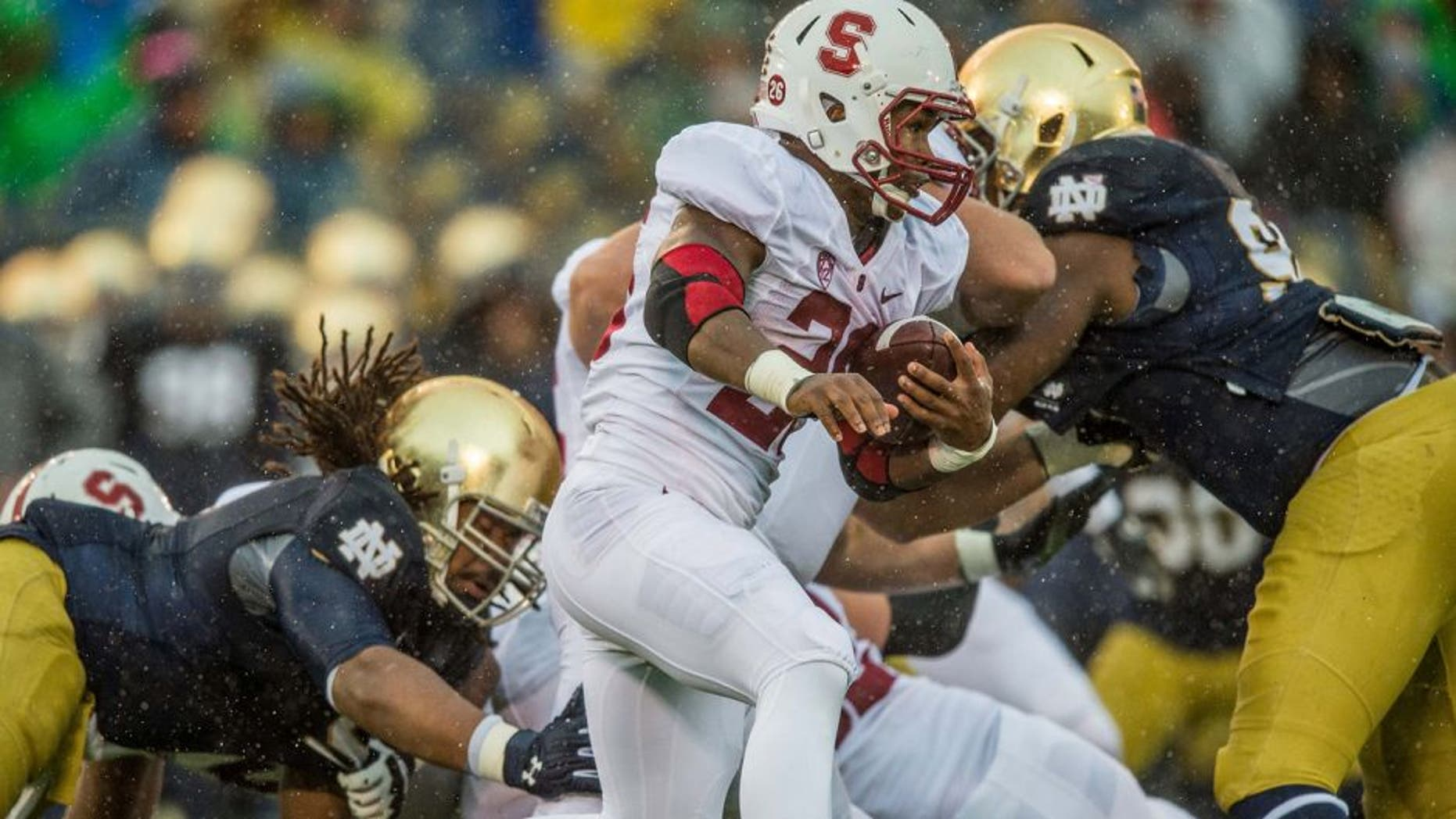 Oct 4, 2014; South Bend, IN, USA; Stanford Cardinal running back Barry Sanders (26) carries the ball in the second quarter against the Notre Dame Fighting Irish at Notre Dame Stadium. Mandatory Credit: Matt Cashore-USA TODAY Sports