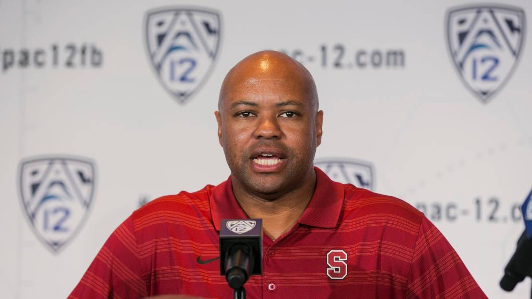 FILE - In this July 24, 2014, file photo, Stanford head coach David Shaw takes questions at the 2014 Pac-12 NCAA college football media days in Los Angeles. Nobody might have been happier when the Pac-12's preseason media poll picked Oregon to win the North Division than Stanford coach Shaw and his players. (AP Photo/Damian Dovarganes, File)