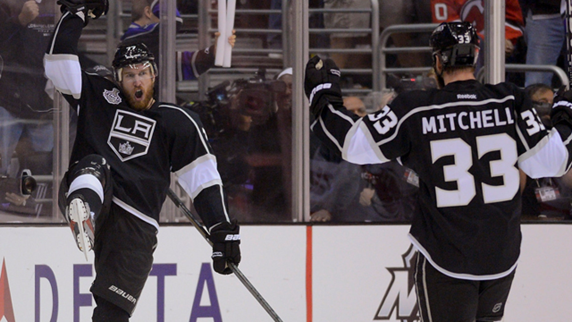 June 4, 2012: Los Angeles Kings center Jeff Carter (77) and Los Angeles Kings defenseman Willie Mitchell (33) react after Carter's third period goal against the New Jersey Devils.