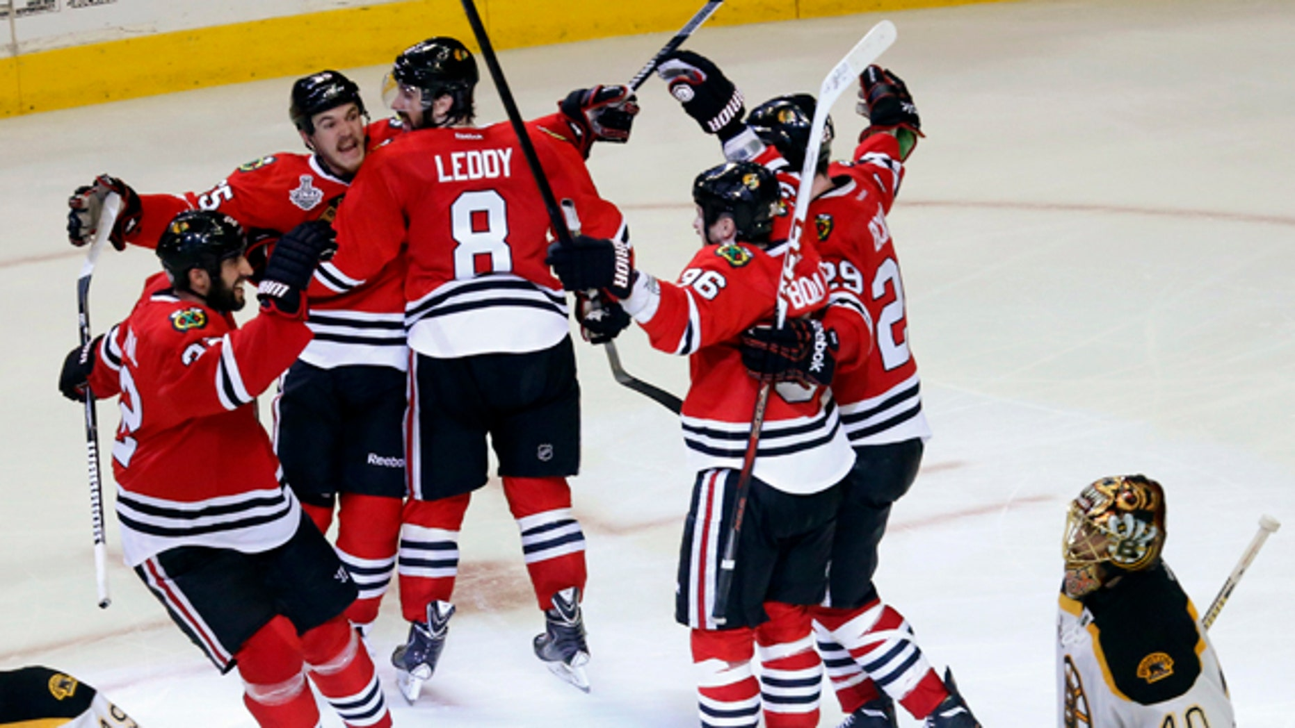 June 13, 2013: Chicago Blackhawks center Andrew Shaw, second from left, celebrates with his teammates after scoring the winning goal during the third overtime period of Game 1 in their NHL Stanley Cup Final hockey series against the Boston Bruins.