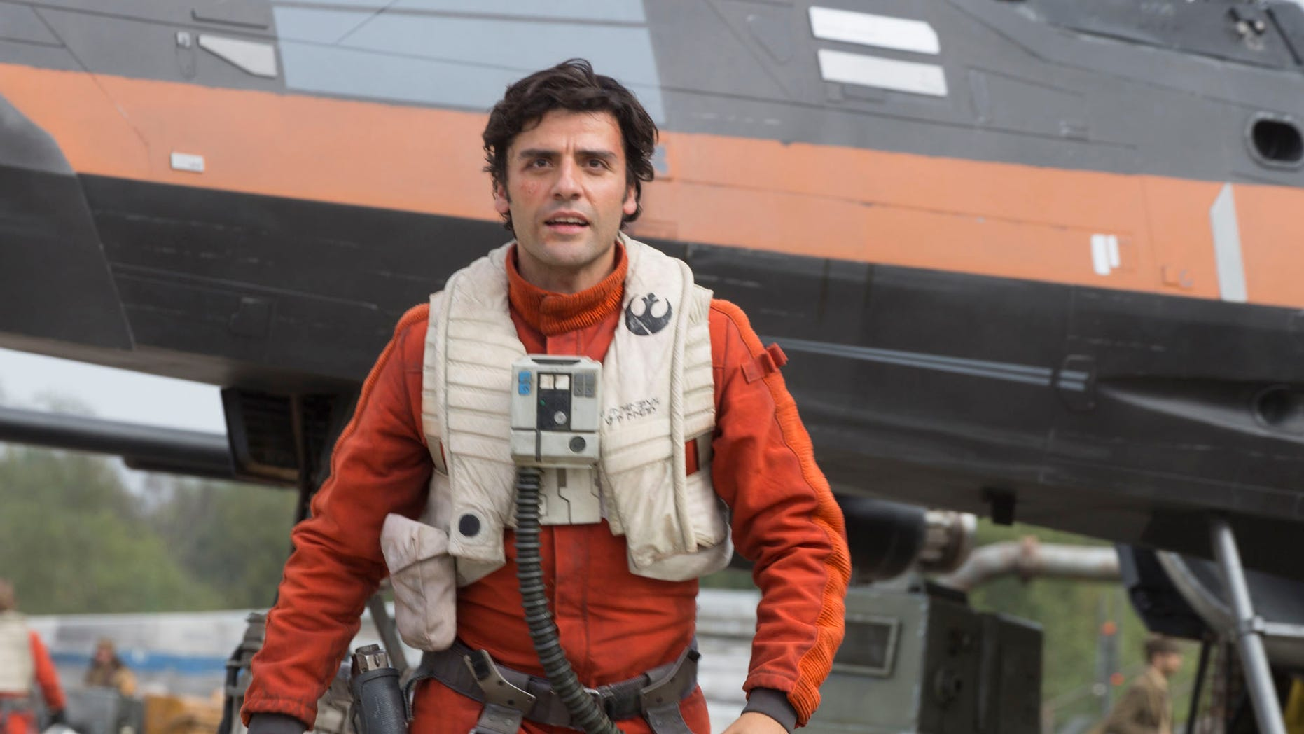 """This photo provided by Disney/Lucasfilm shows Oscar Isaac as Poe Dameron in a scene from """"Star Wars: The Force Awakens,"""" directed by J. J. Abrams. The new film releases in U.S. theaters on Dec. 18, 2015. (David James/Disney/Lucasfilm via AP)"""