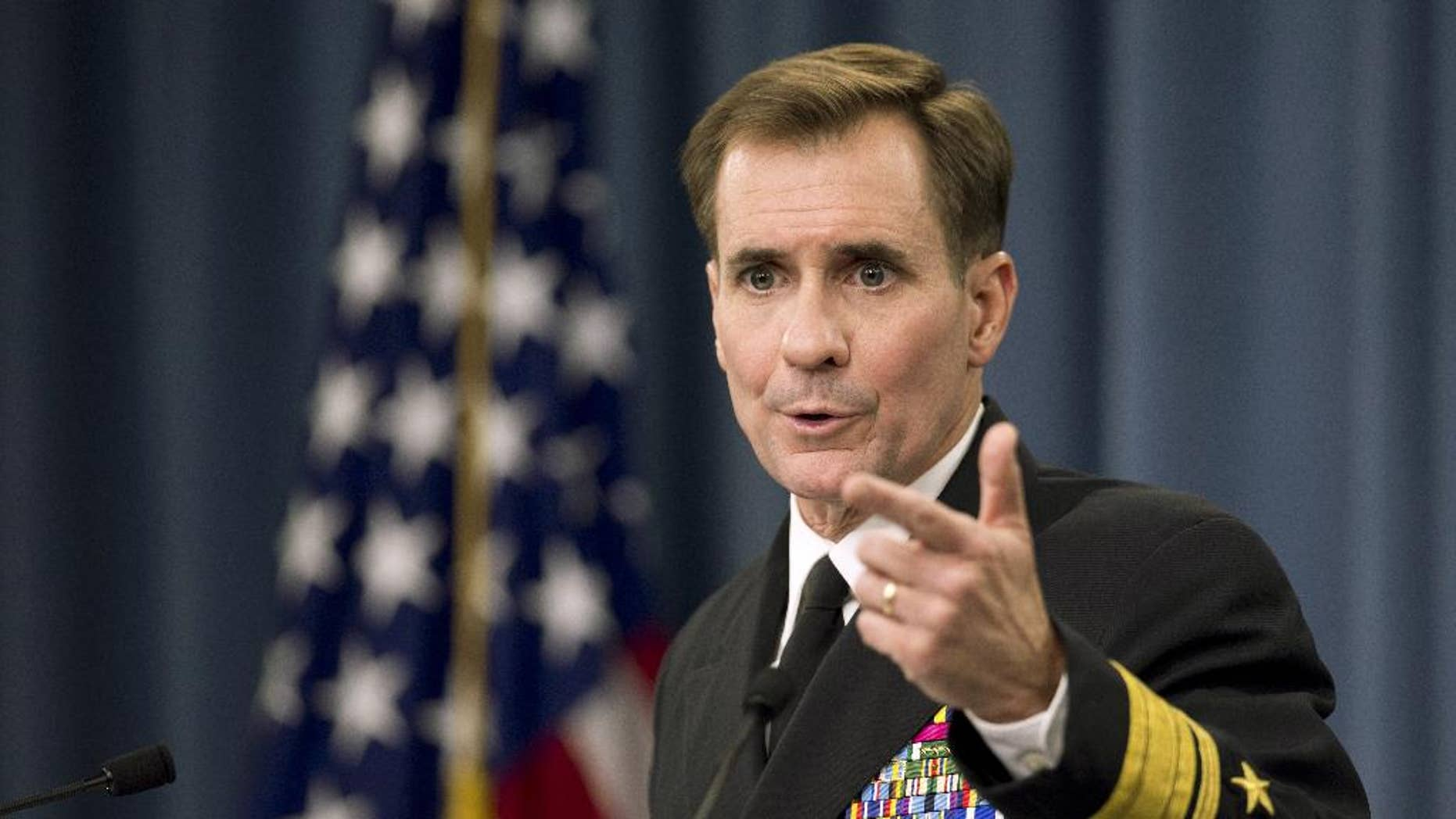 FILE - In this Nov. 7, 2014 file photo, Department of Defense Press Secretary Rear Admiral John Kirby, speaks to reporters during a news conference, at the Pentagon. U.S. officials say former Pentagon spokesman Admiral John Kirby will retire from the military and move to the State Department to be that agency's new public face.   The officials say Secretary of State John Kerry tapped Kirby to be the department's spokesman. (AP Photo/Manuel Balce Ceneta)