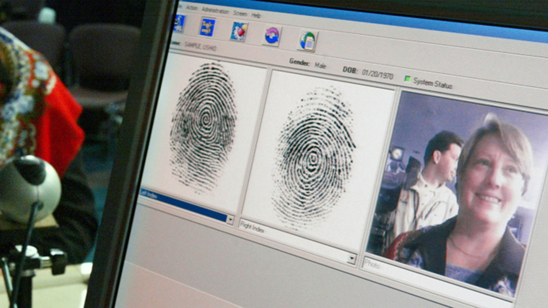 WASHINGTON - OCTOBER 28:  Penelope Smith, of the US-VISIT Program, demonstrates the process of inkless fingerprints scanning during a news conference on the program October 28, 2003 in Washington, DC. The U.S. Department of Homeland Security unveiled the US-VISIT Program, which will capture more complete arrival and departure data, such as fingerprints and mug shots, at airports and seaports from visitors who require a visa to enter the United States.  (Photo by Alex Wong/Getty Images)