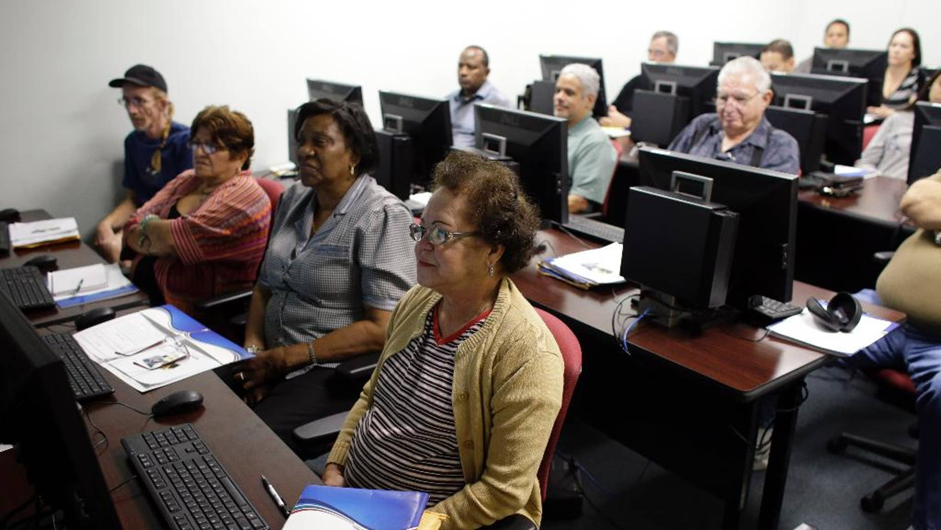 In this Feb. 6 2014 photo, Margarita Sanchez, 72, of Hollywood, Fla., front, listens during a job search workshop at WorkForce One in Davie, Fla. The government reports on state unemployment rates for January on Monday, March 17, 2014. (AP Photo/Lynne Sladky, File)