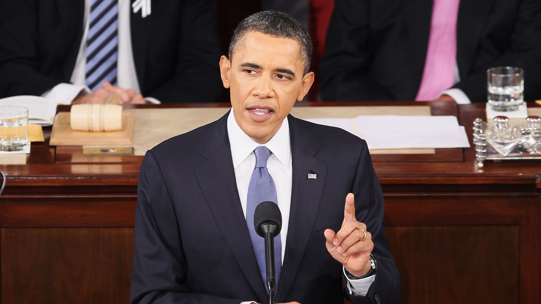 FILE U.S. President Barack Obama, flanked by Vice President Joe Biden (L) and Speaker of the House John Boehner (R-OH), addresses a Joint Session of Congress while delivering his State of the Union speech January 25, 2011 in Washington, DC. During his speech Obama was expected to focus on the U.S. economy and increasing education and infrastructure funding while proposing a three-year partial freeze of domestic programs and $78 billion in military spending cuts.  (Photo by Alex Wong/Getty Images) *** Local Caption ***