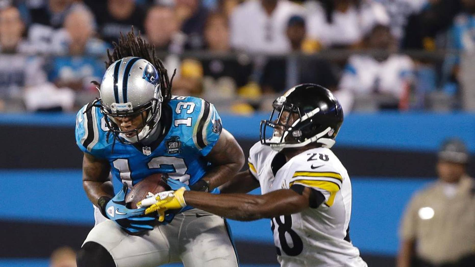Carolina Panthers' Kelvin Benjamin (13) catches a pass as Pittsburgh Steelers' Cortez Allen (28) defends during the second half of an NFL football game in Charlotte, N.C., Sunday, Sept. 21, 2014. (AP Photo/Bob Leverone)