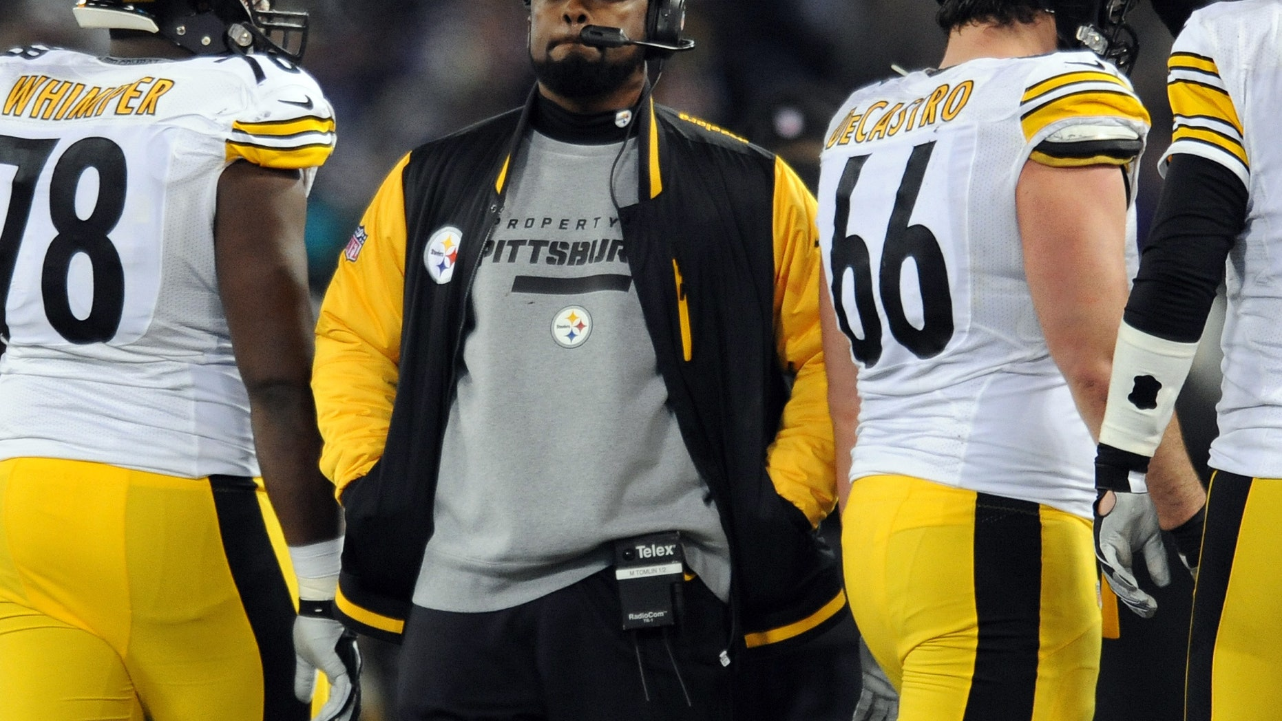 Nov. 28, 2013: In this file photo, Pittsburgh Steelers coach Mike Tomlin stands on the sideline during an official play review in the second half of an NFL football game against the Baltimore Ravens, in Baltimore.