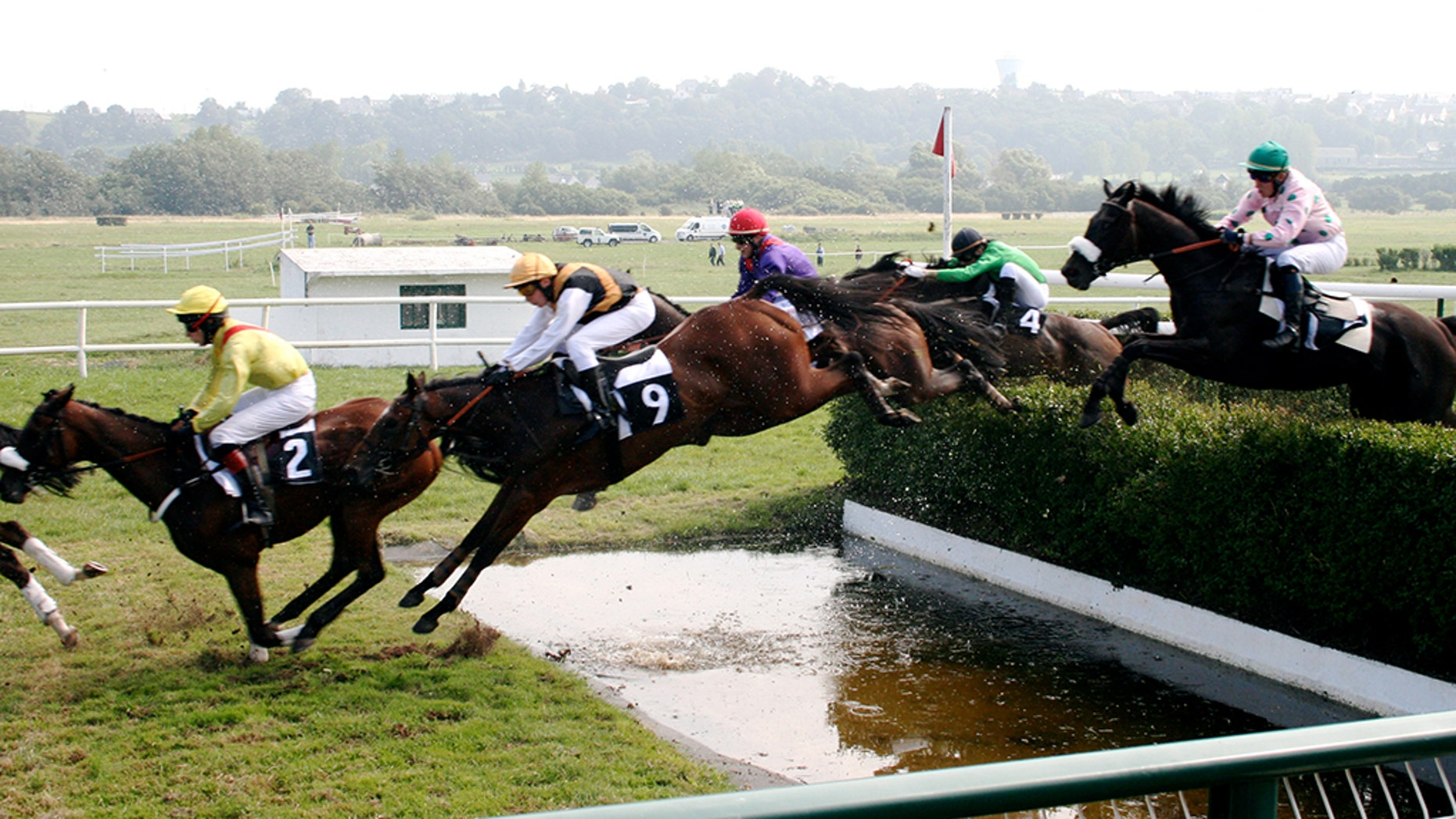 Photo taken during the running of a steeplechase race.