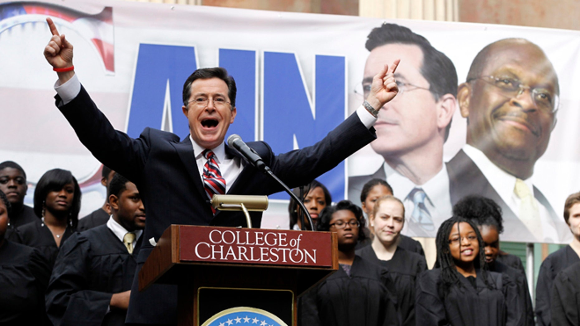 FILE:  January 20, 2012: Stephen Colbert hosts a rally with then-GOP presidential candidate Herman Cain, at the College of Charleston, in South Carolina.