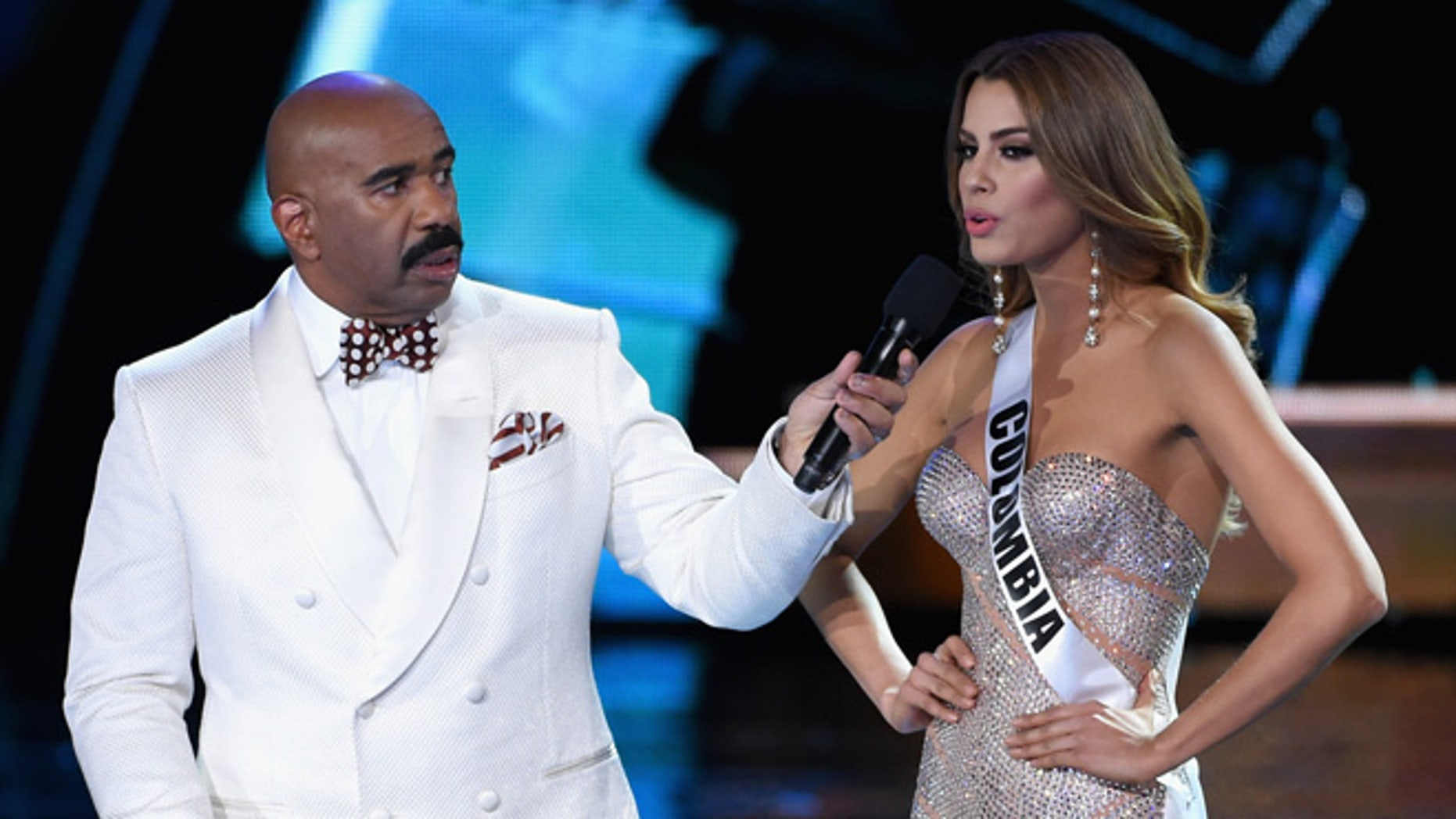 Steve Harvey listens as Miss Colombia answers a question during the 2015 Miss Universe Pageant on Dec. 20, 2015.