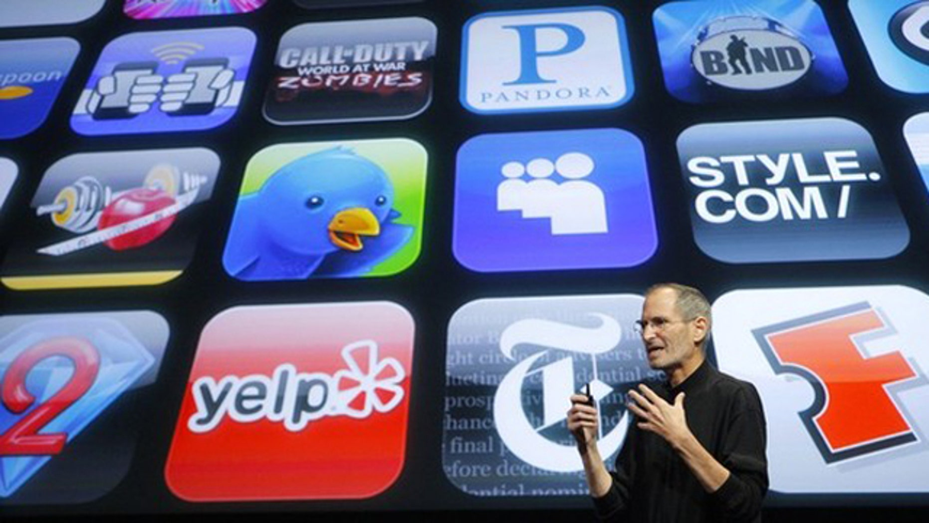 April 8, 2010: Apple Chief Executive Steve Jobs speaks in front of a display showing icons of various apps during the iPhone OS4 special event at Apple headquarters in Cupertino, Calif.