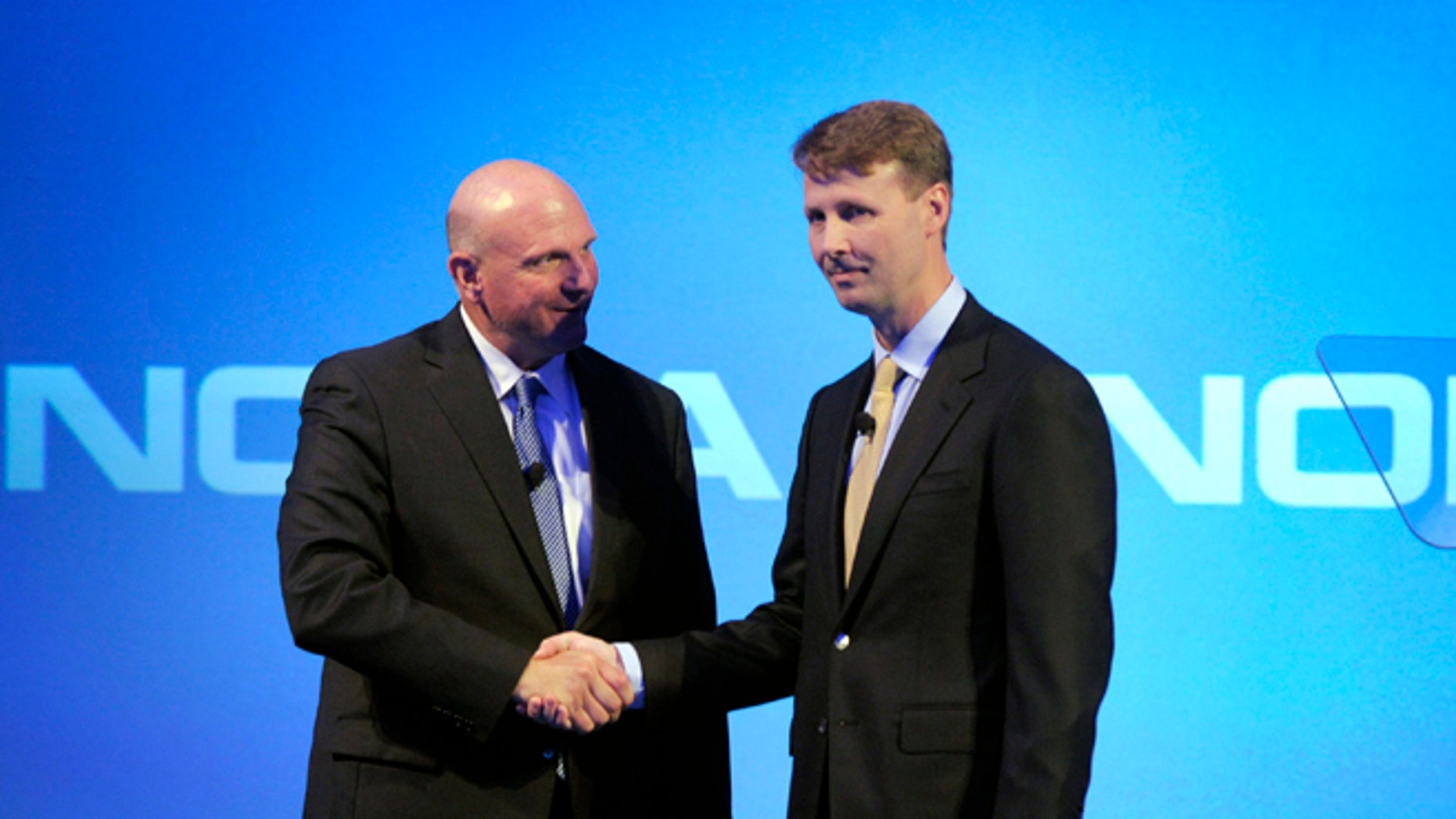 Microsoft CEO Steve Ballmer shakes hands with Nokia's Chairman of the Board Risto Siilasmaa (R) during the news conference of Finnish mobile phone manufacturer Nokia in Espoo, September 3, 2013.