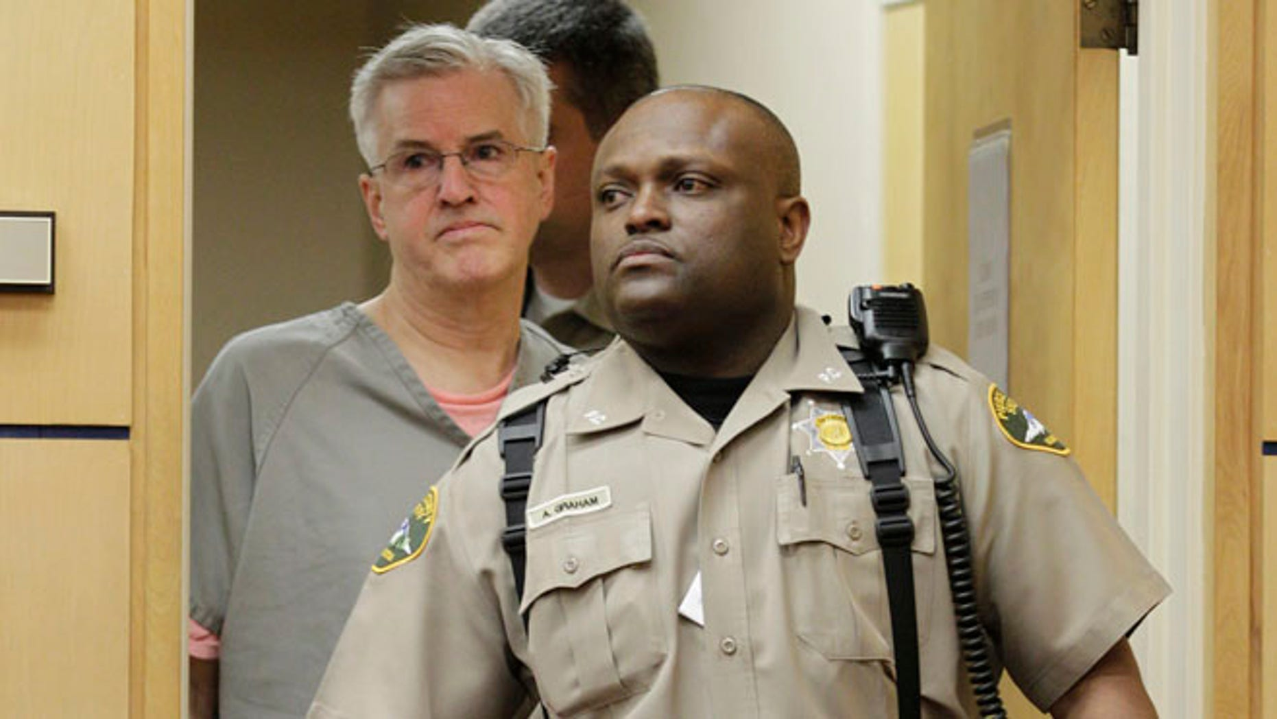 April 23: Steve Powell is led into in a Pierce County Superior Court hearing in Tacoma, Wash.