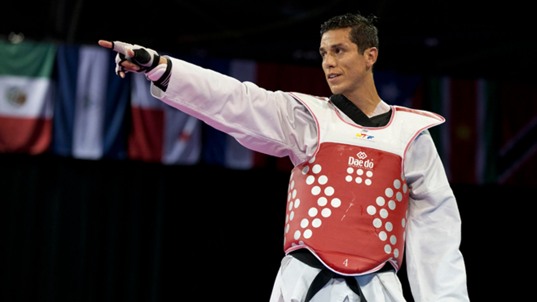 FILE - In this July 21, 2015 file photo, United States' Steven Lopez celebrates winning a bronze medal by defeating Venezuela's Javier Medina in the men's taekwondo under-80kg category at the Pan Am Games in Mississauga, Ontario. Lopez is competing on the Olympic stage for the fifth time, at the Summer Games in Rio de Janeiro, Brazil, where he's looking to add a medal to the ones he claimed in 2000, 2004 and 2008.  (AP Photo/Rebecca Blackwell, File)