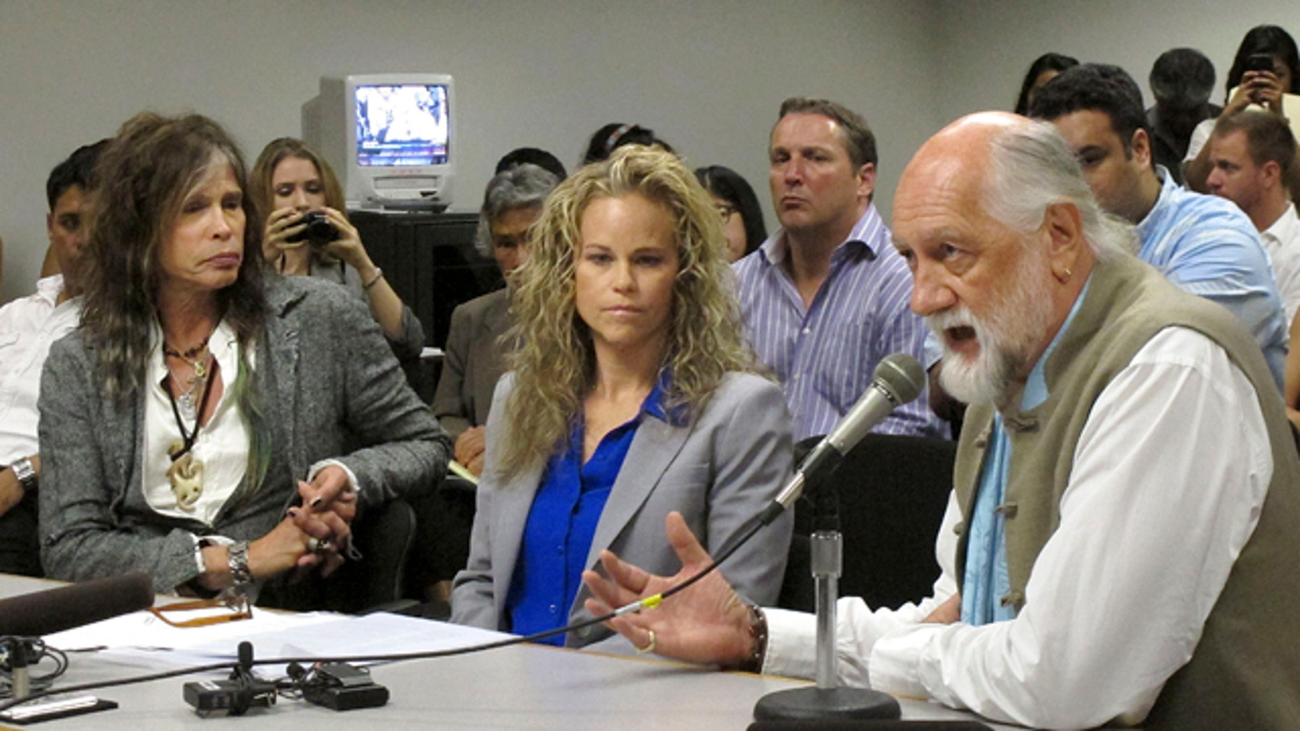 Feb. 8, 2013: Aerosmith lead singer Steven Tyler, left, his attorney Dina LaPolt, center, listen as Fleetwood Mac drummer Mick Fleetwood testifies on celebrity privacy during a hearing at the Hawaii Capitol in Honolulu.