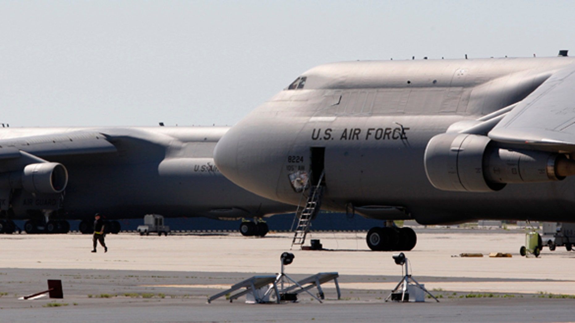 U.S. Air National Guard C-5 jets sit on the tarmac at Stewart Air National Guard Base in Newburgh, New York, May 21, 2009. The FBI and New York police arrested four Muslim men in Newburgh on Wednesday night after they planted what they believed to be explosives in two cars -- one parked outside each synagogue -- and planned to head to Stewart Air base with what they thought was an activated stinger surface-to-air missile.  REUTERS/Mike Segar  (UNITED STATES CRIME LAW MILITARY RELIGION TRANSPORT)