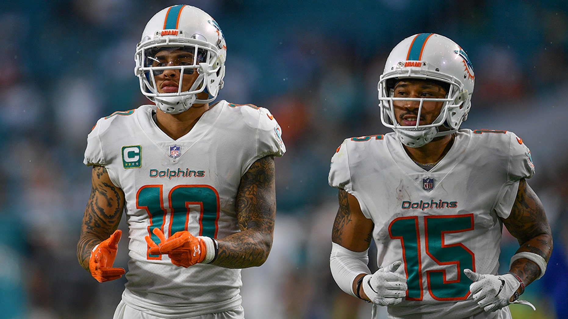 Miami Dolphins players Kenny Stills, left, and Albert Wilson took a knee during the national anthem before Sunday's game against the New York Jets, continuing the protest Colin Kaepernick started.