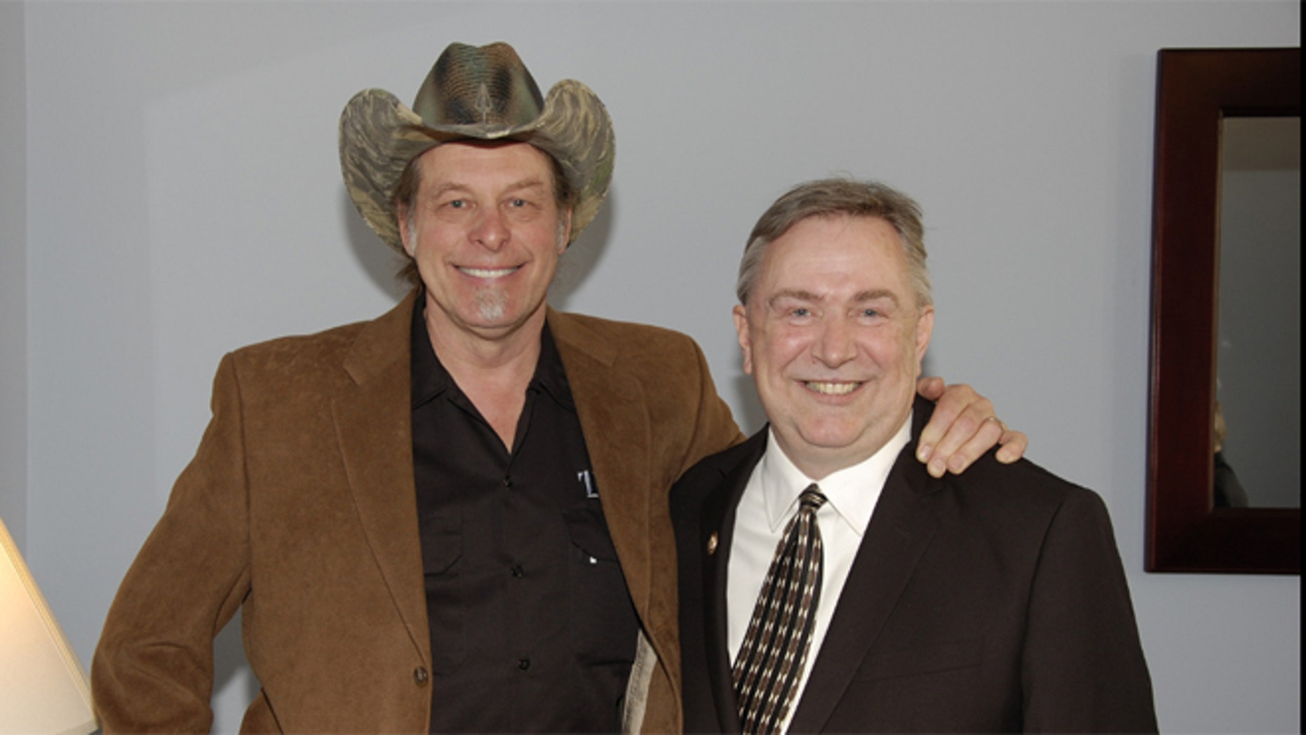 FILE: Feb. 12, 2013: Texas GOP Rep. Steve Stockman and rock star Ted Nugent,in Washington, D.C.