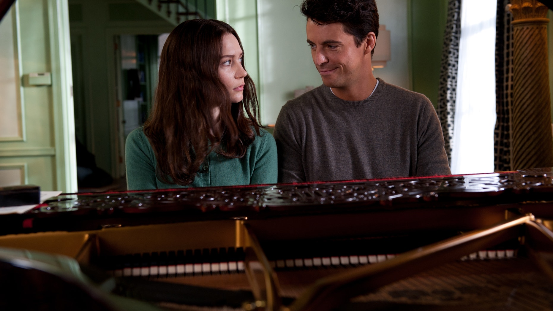 """This film image released by Fox Searchlight Pictures shows Mia Wasikowska, left, and Matthew Goode in a scene from """"Stoker."""""""