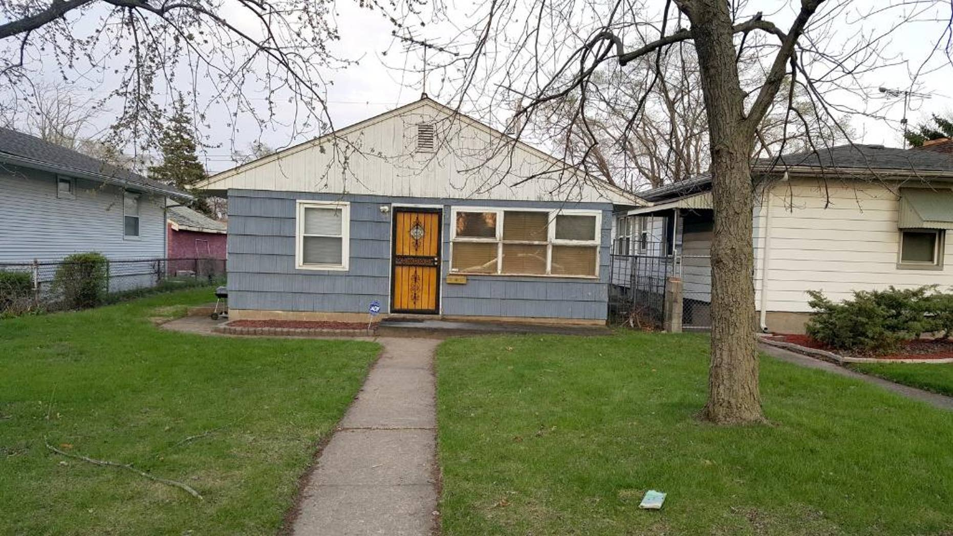This Tuesday, April 21, 205 photo shows the home where the body of a woman was found by police in Gary, Ind.  Madison County prosecutors filed paperwork in Circuit Court on Monday charging Geraldine Jones, 36, of Gary in the death of 23-year-old Samantha Fleming of Anderson.  Police investigating Fleming's disappearance on Friday found her body in Jones' home in Gary, about 165 miles northwest of Anderson. When police arrived Fleming's 3-week-old daughter was being held by Jones' sister, who told police she had been caring for her sister's child while her sister was in Texas. Police determined the child was Fleming's and the baby was returned to relatives in Indianapolis.   (Michelle L. Quinn/Chicago Tribune via AP) MANDATORY CREDIT CHICAGO TRIBUNE; CHICAGO SUN-TIMES OUT; DAILY HERALD OUT; NORTHWEST HERALD OUT; THE HERALD-NEWS OUT; DAILY CHRONICLE OUT; THE TIMES OF NORTHWEST INDIANA OUT; TV OUT; MAGS OUT; NO SALES