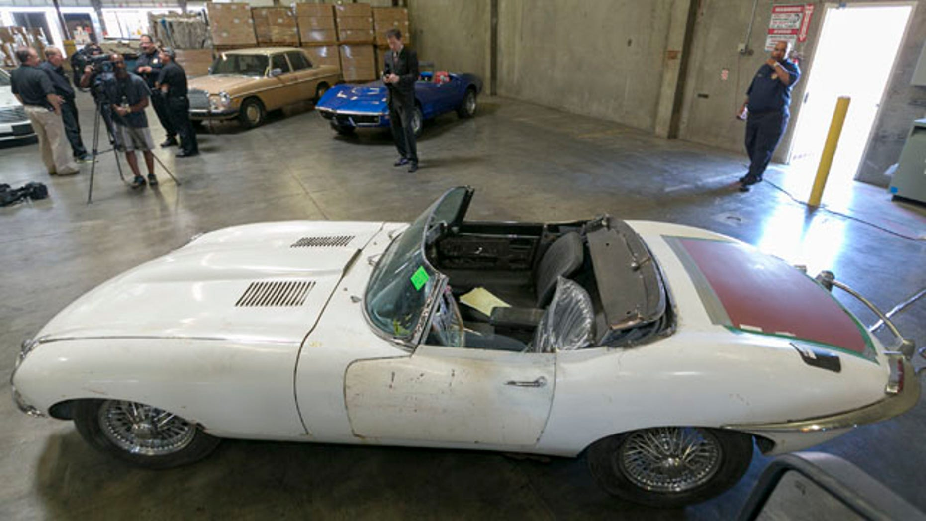 September 17, 2014: A 1967 Jaguar XK-E convertible that was stolen 46 years ago is shown to the media by the U.S. Customs and Protection agency in Carson, Calif. The car was recovered at the Port of Long Beach by the California Highway Patrol along with four other cars in a container en route to the Netherlands. (AP Photo/Damian Dovarganes)