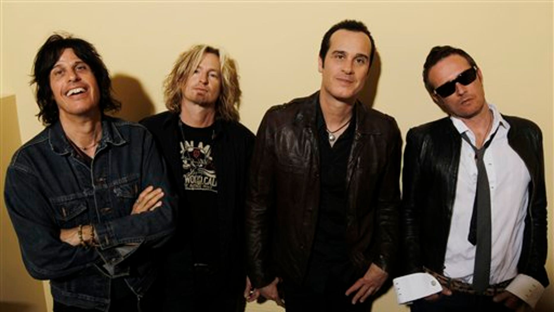 This April 30, 2010 file photo shows the Stone Temple Pilots, from left, Dean Deleo, Eric Kretz, Robert Deleo, and Scott Weiland from the band Stone Temple Pilots, pose for a portrait in Santa Monica, Calif.