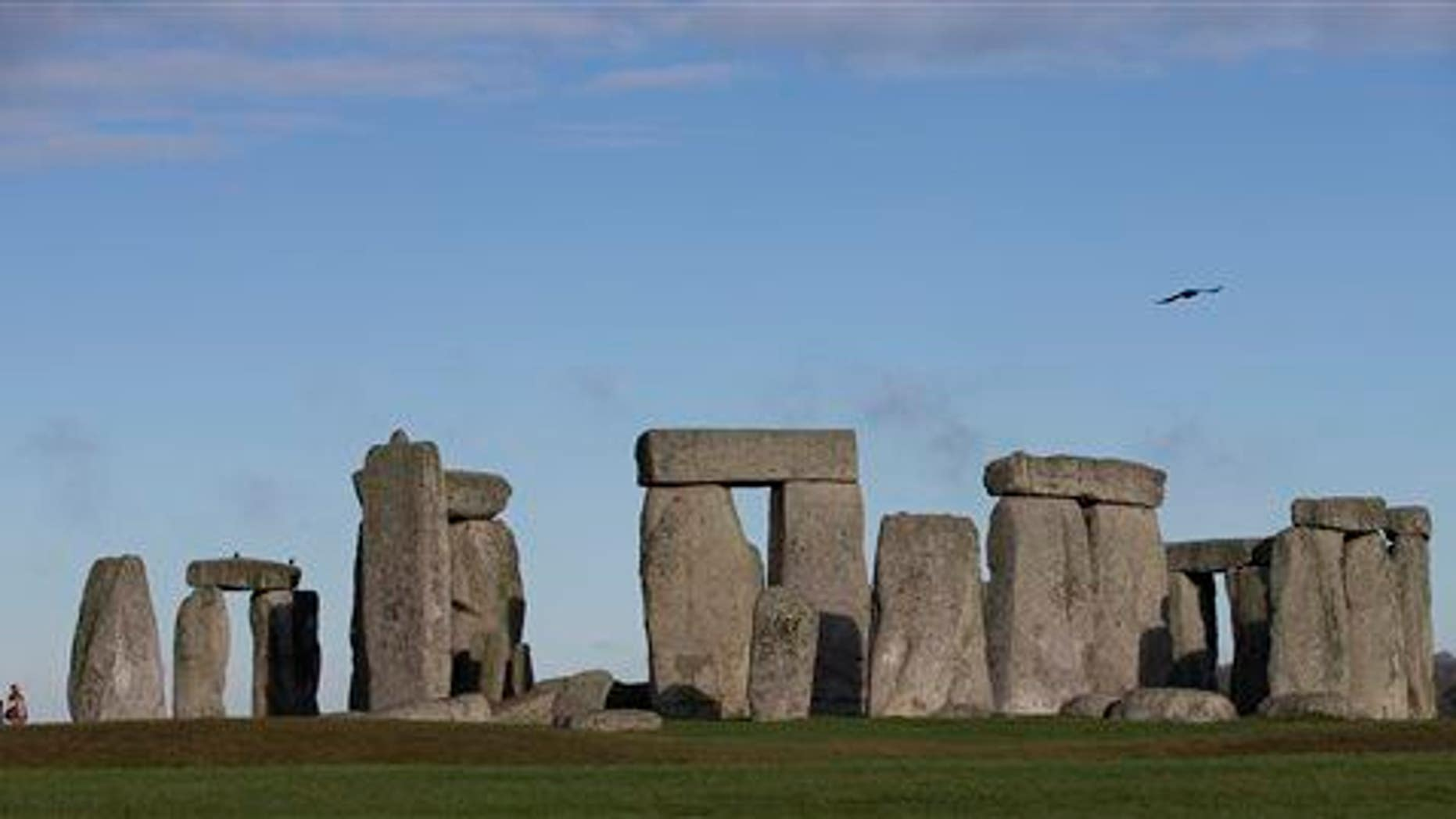 Visitors take photographs of the world heritage site of Stonehenge, Tuesday, Dec. 17, 2013.