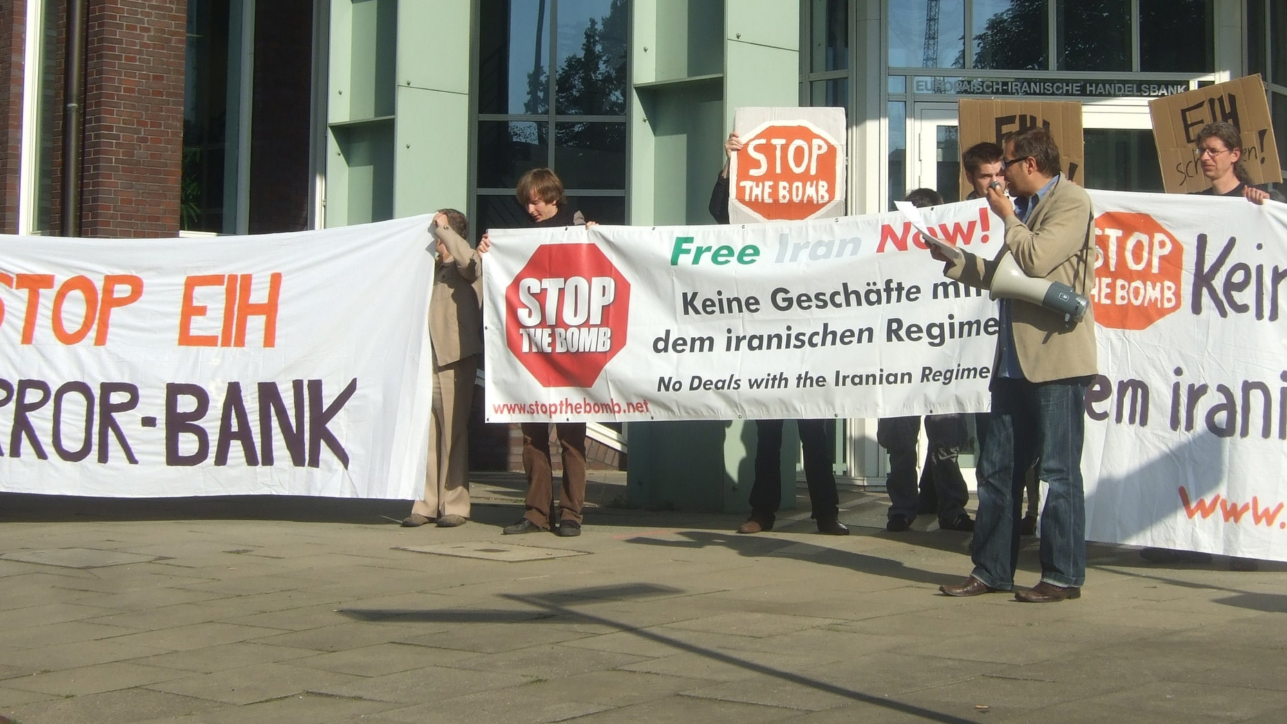The activist group Stop the Bomb protests EIH 'terror bank.'