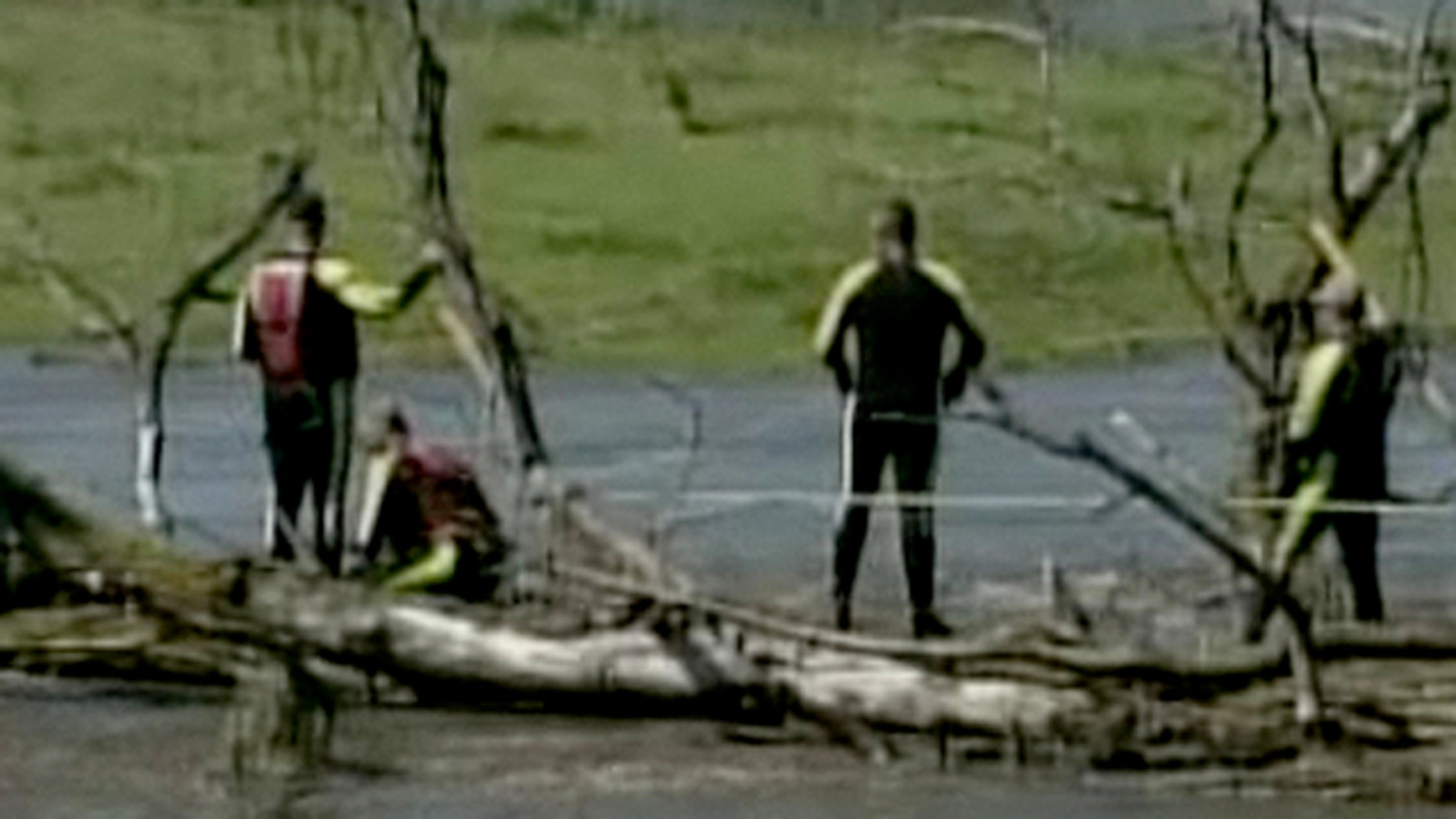 Aug. 11: Rescue workers search for the body of a missing woman who was in one of three cars swept off the road by flood waters in Des Moines, Iowa.