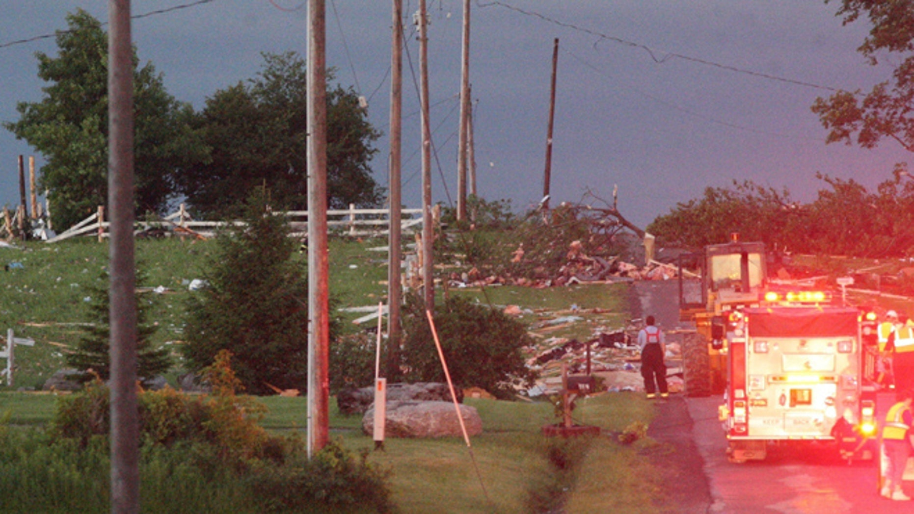 July 8: Debris is visible at Goff Road in Smithfield, N.Y., following a severe storm.