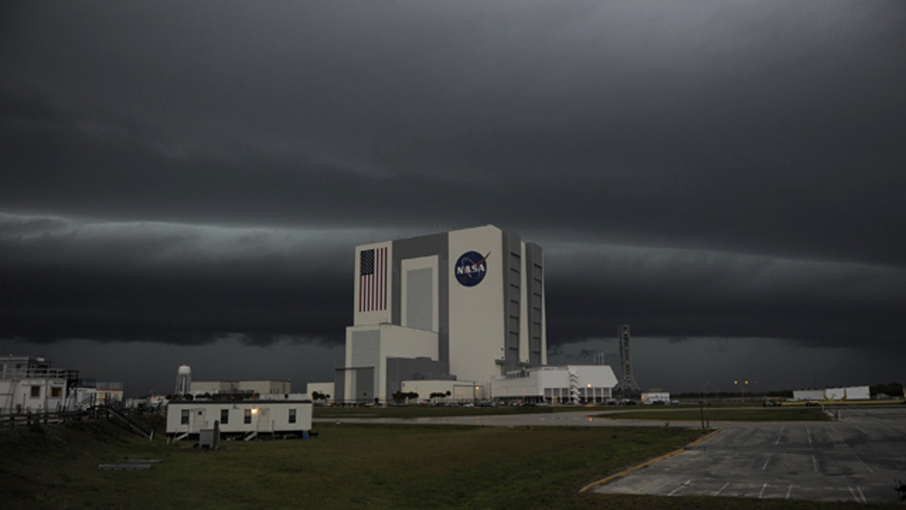 Severe storms darken the skies over Kennedy Space Center in Florida Thursday, causing delays in space shuttle Endeavours STS-134 mission launch dress rehearsal.