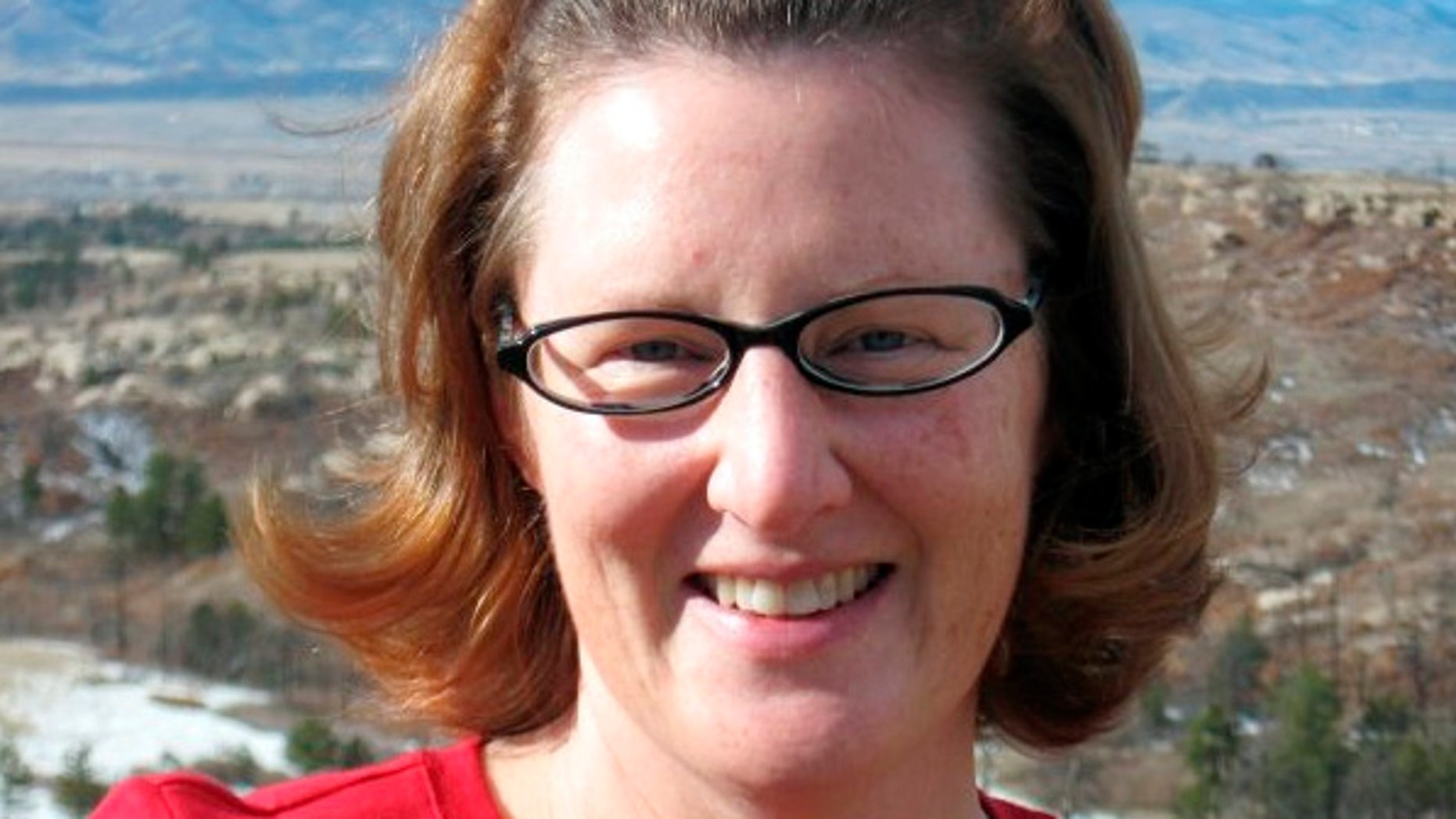 In this undated photo provided by Kristin Hopkins' family via St. Anthony Hospital shows Hopkins, 43, of Highlands Ranch, Colo. Hopkins drove off the roadway near the old mining town of Fairplay sometime after she was last seen on April 27, 2014. Authorities say at least one motorist hiked down from Red Hill Pass on U.S. Highway 285 and alerted authorities on Sunday, May 4, that there was a body inside the car. Rescuers found Hopkins alive, conscious and coherent — but critically injured and extremely dehydrated. (AP Photo/Kristin Hopkins' family via St. Anthony Hospital)