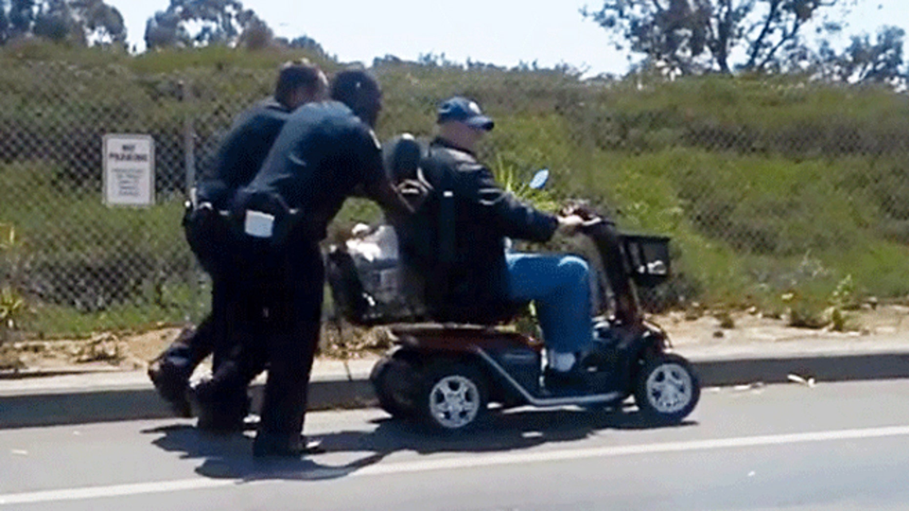 Video shows officers pushing disabled veteran after his scooter lost power.