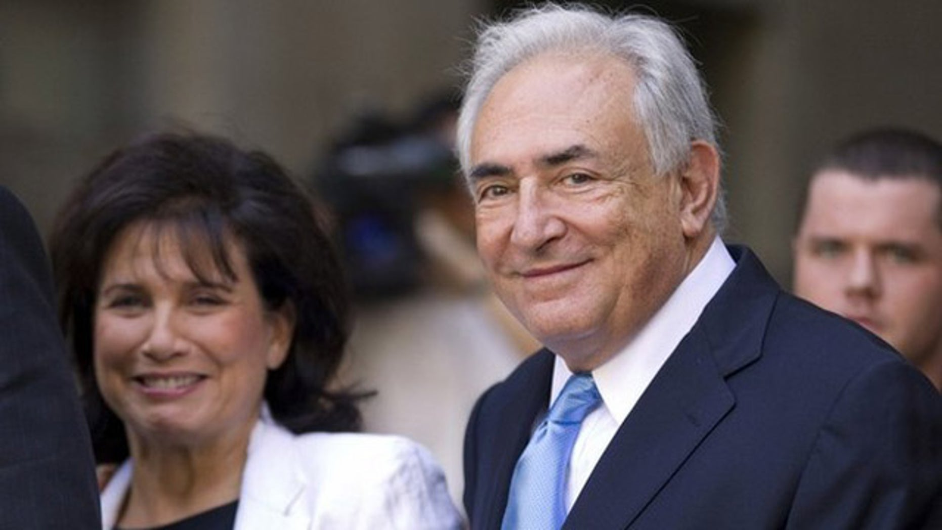July 1: Former IMF chief Dominique Strauss-Kahn smiles as he and his wife Anne Sinclair depart a hearing at the New York State Supreme Courthouse in New York. Strauss-Kahn was released without bail on Friday after a dramatic court hearing where the sexual assault case against him appeared to shift in his favor.