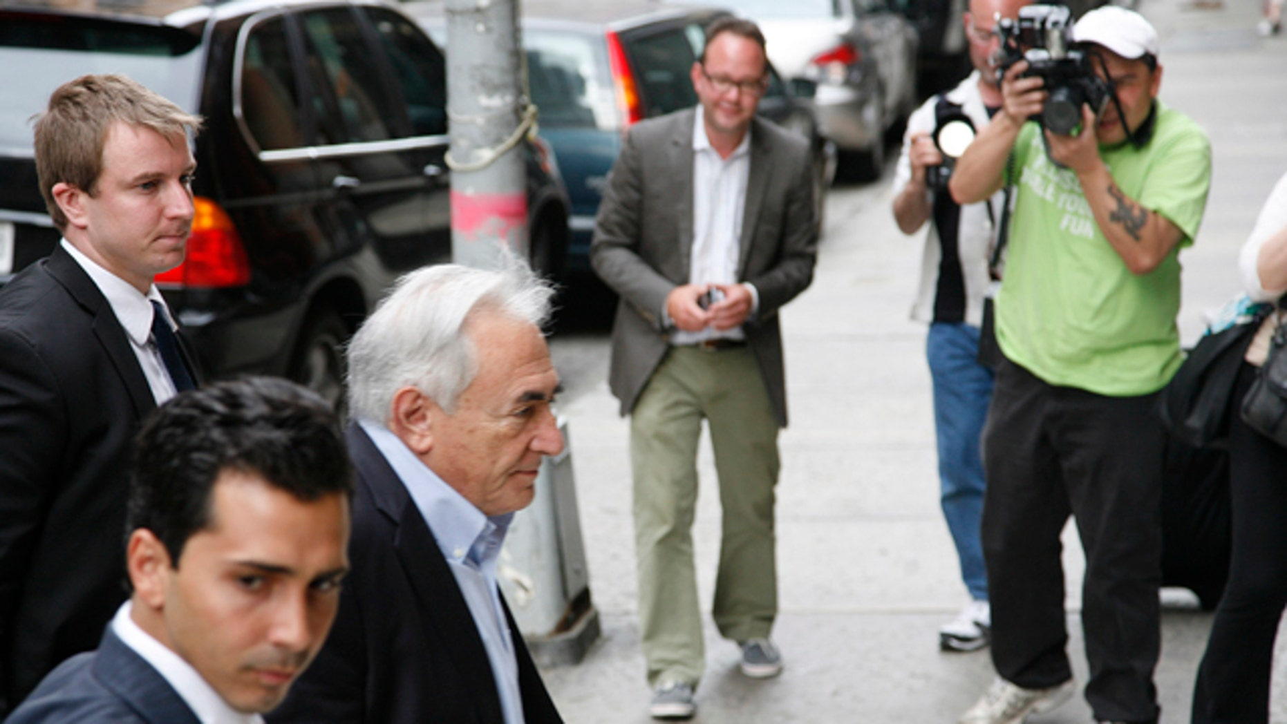 July 2: Doninique Strauss-Kahn returns to his house in the Tribeca section of downtown Manhattan.