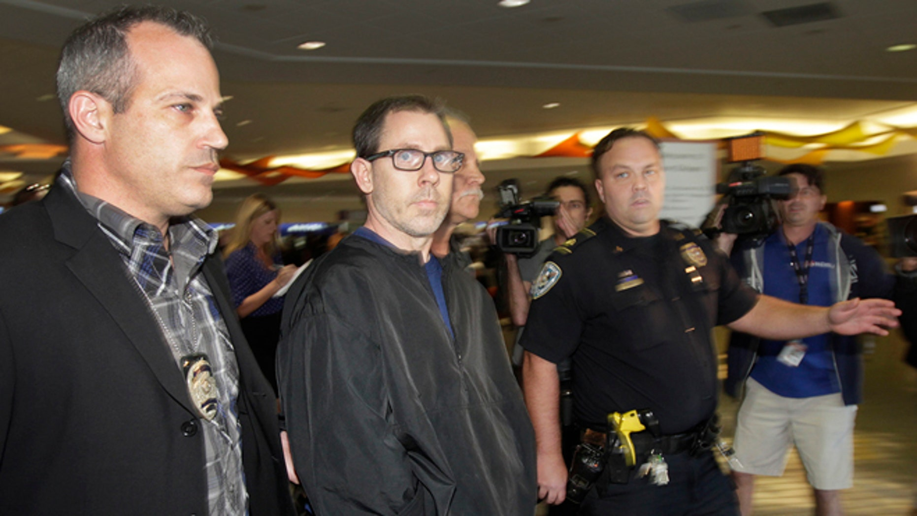 FILE - In a Oct. 15, 2014 file photo, Terry Speaks, center, a suspect in the 2012 stabbing and dismemberment of a Bourbon Street strip club dancer, arrives under heavy police guard at Louis Armstrong International Airport in Kenner, La. Trial is set to open Monday, June 15, 2015, for Speaks, accused of killing a New Orleans' French Quarter stripper in 2012, dismembering her and dumping body parts of the woman into the Gulf of Mexico. (Chris Granger/NOLA.com The Times-Picayune via AP, File) MAGS OUT; NO SALES; USA TODAY OUT; THE BATON ROUGE ADVOCATE OUT