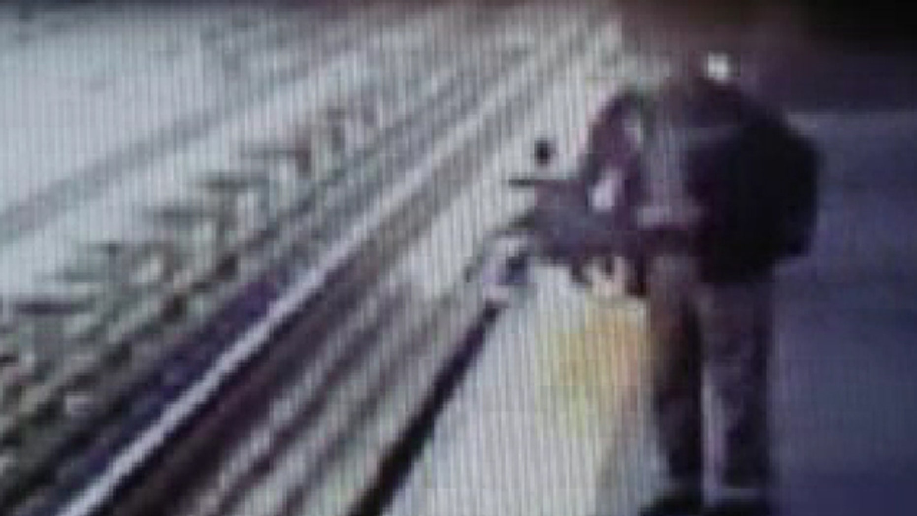 May 16, 2013: A baby's stroller falls into the train tracks in Philly in this video still.